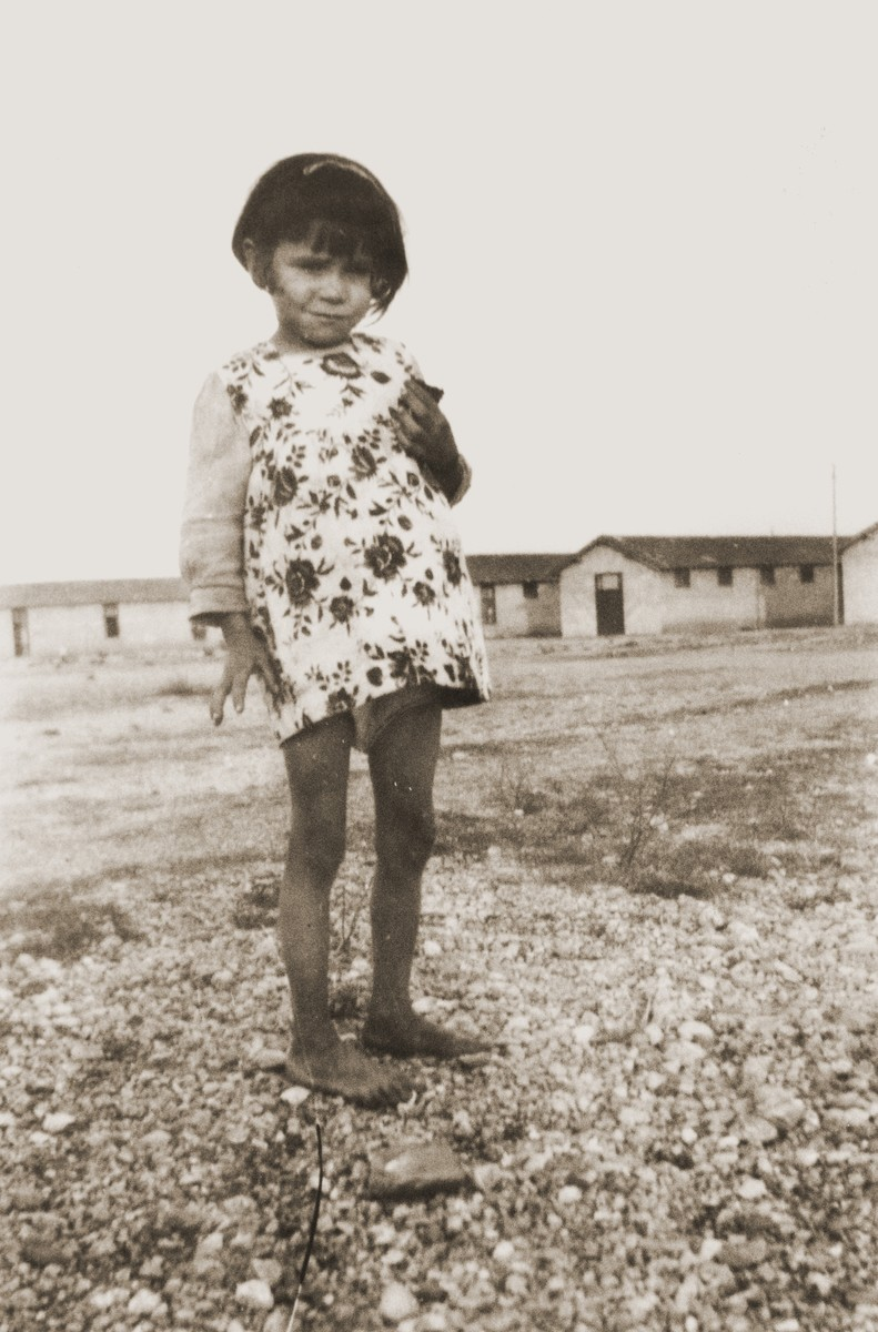"""Portrait of a Romani (Gypsy) girl in the Rivesaltes detention camp.    The photo's original caption reads """"Annette, the shy little Gypsy girl who never spoke""""."""