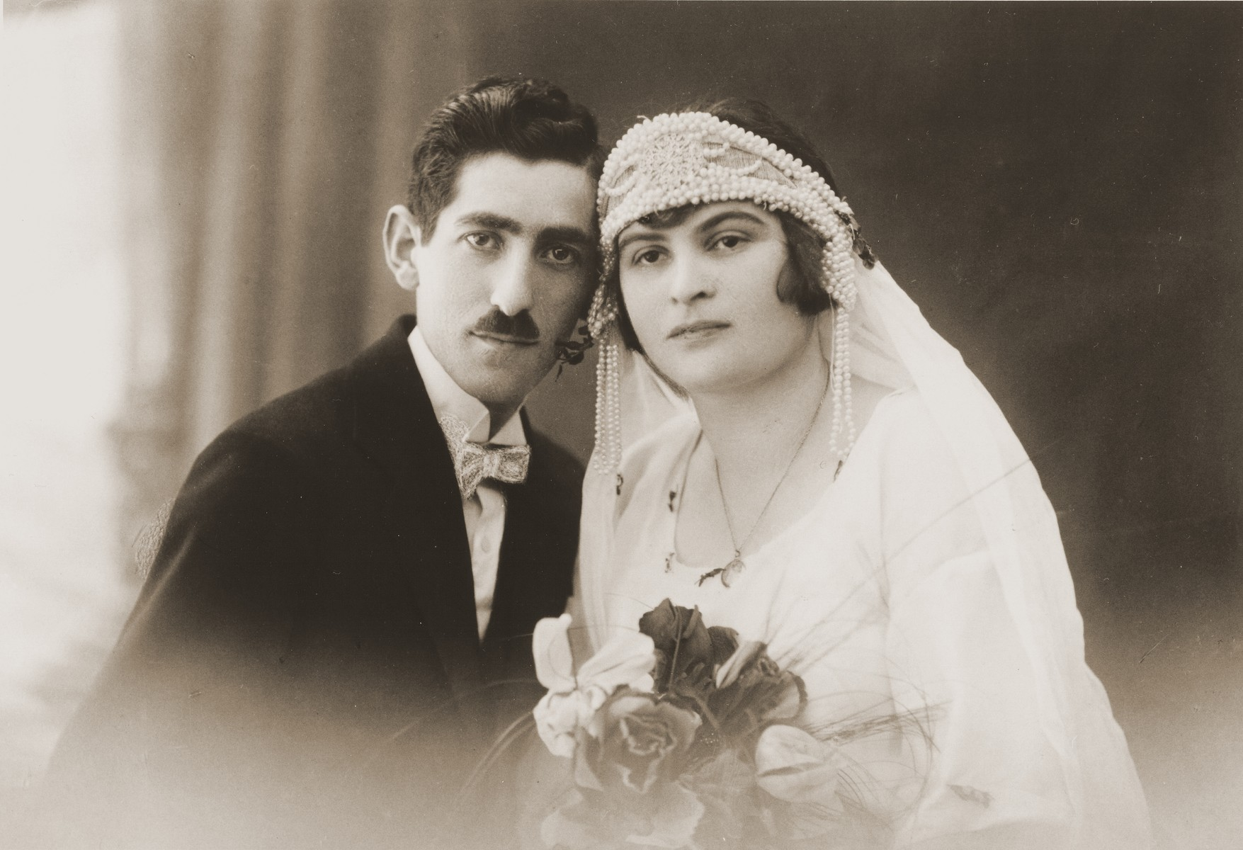 Wedding portrait of a Jewish couple in Lvov, Poland.  Pictured are Marie Harmelin (who was interned on the Isle of Man during World War II and survived) and Solomon Auerbach (who perished in Dachau or Mauthausen), relatives of the donor.