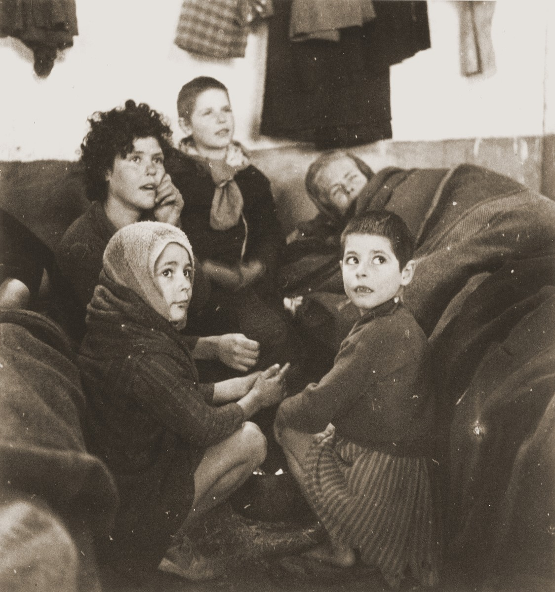 Women and children try to stay warm in their Rivesaltes barracks.