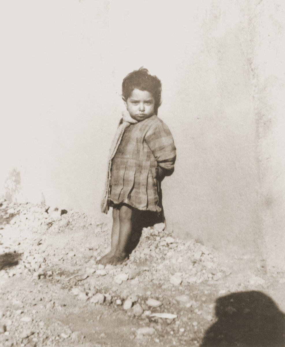 "A Romani (Gypsy) child in Rivesaltes.    The photo's original caption reads ""Don't touch me!"""