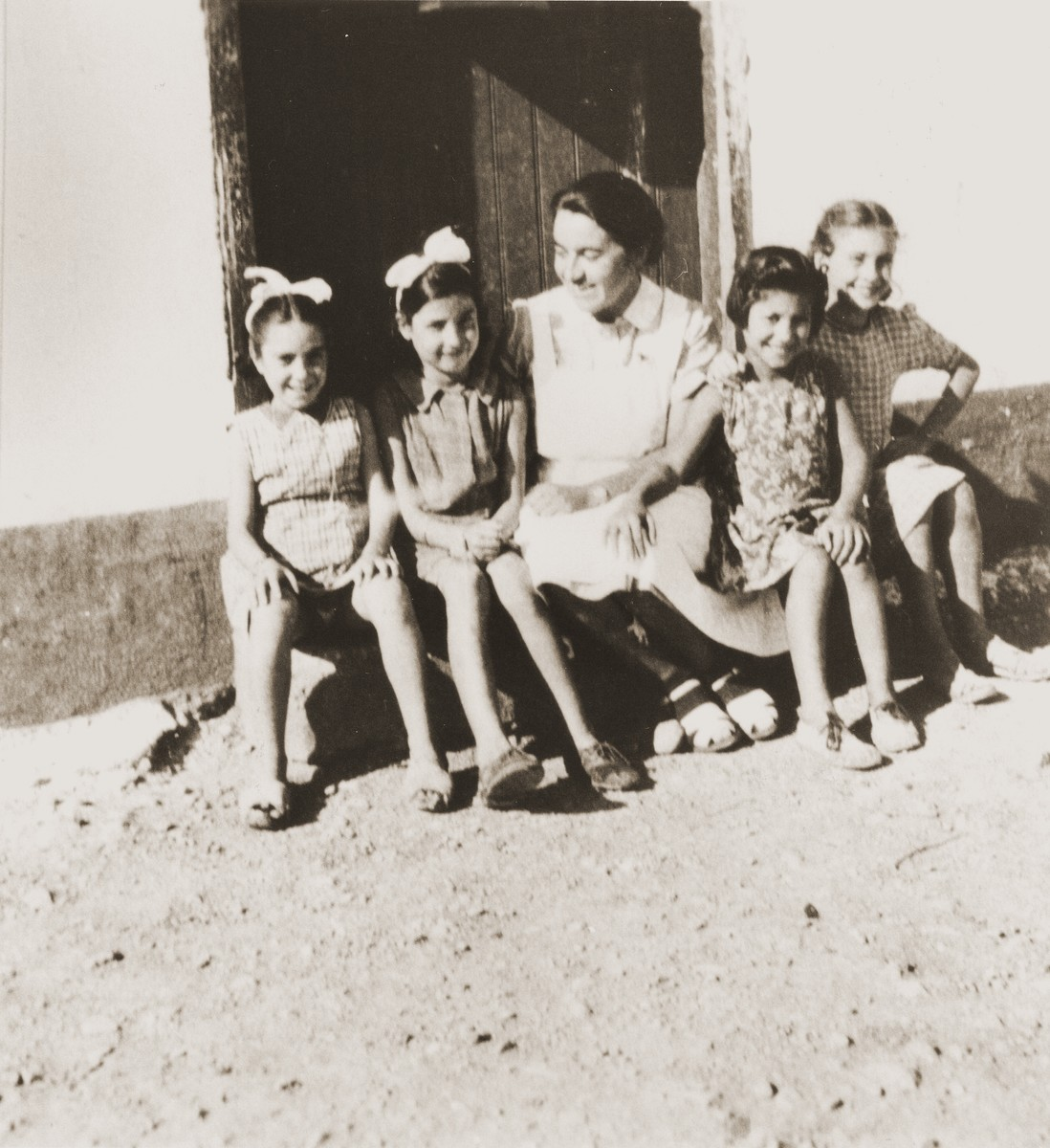Spanish children visit with Friedel Reiter on a Sunday morning in the Rivesaltes internment camp.