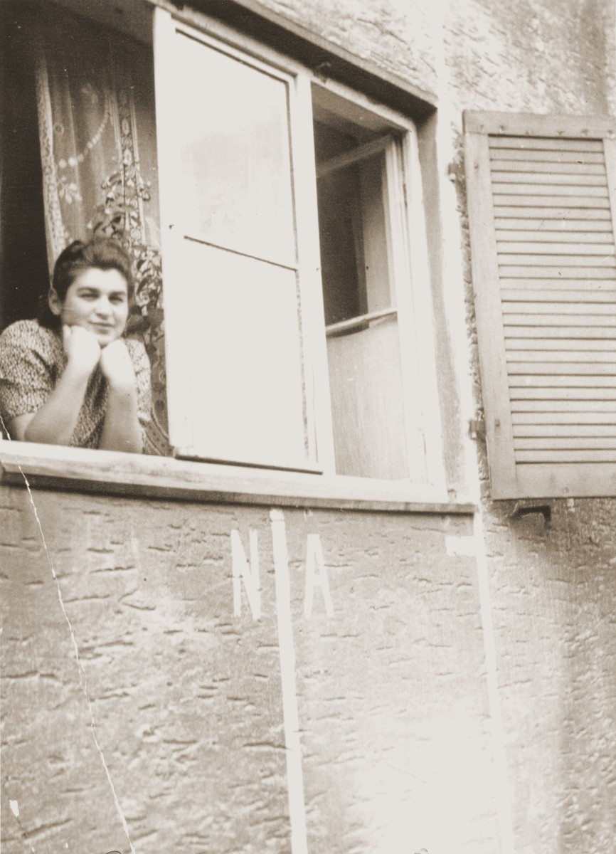A young woman poses at the window of her residence in the Fuerth displaced persons camp.  Pictured is Eugenia (Hochberg) Lanceter.