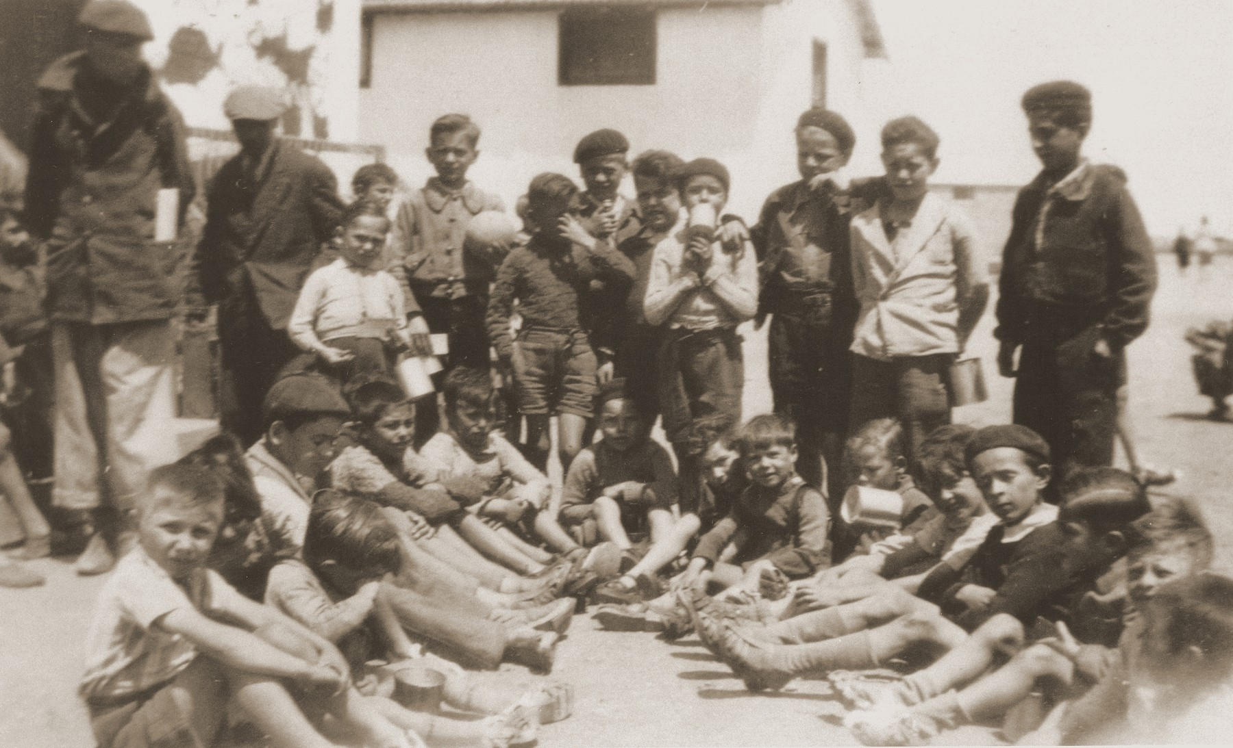 Children at the Rivesaltes internment camp receive new shoes.