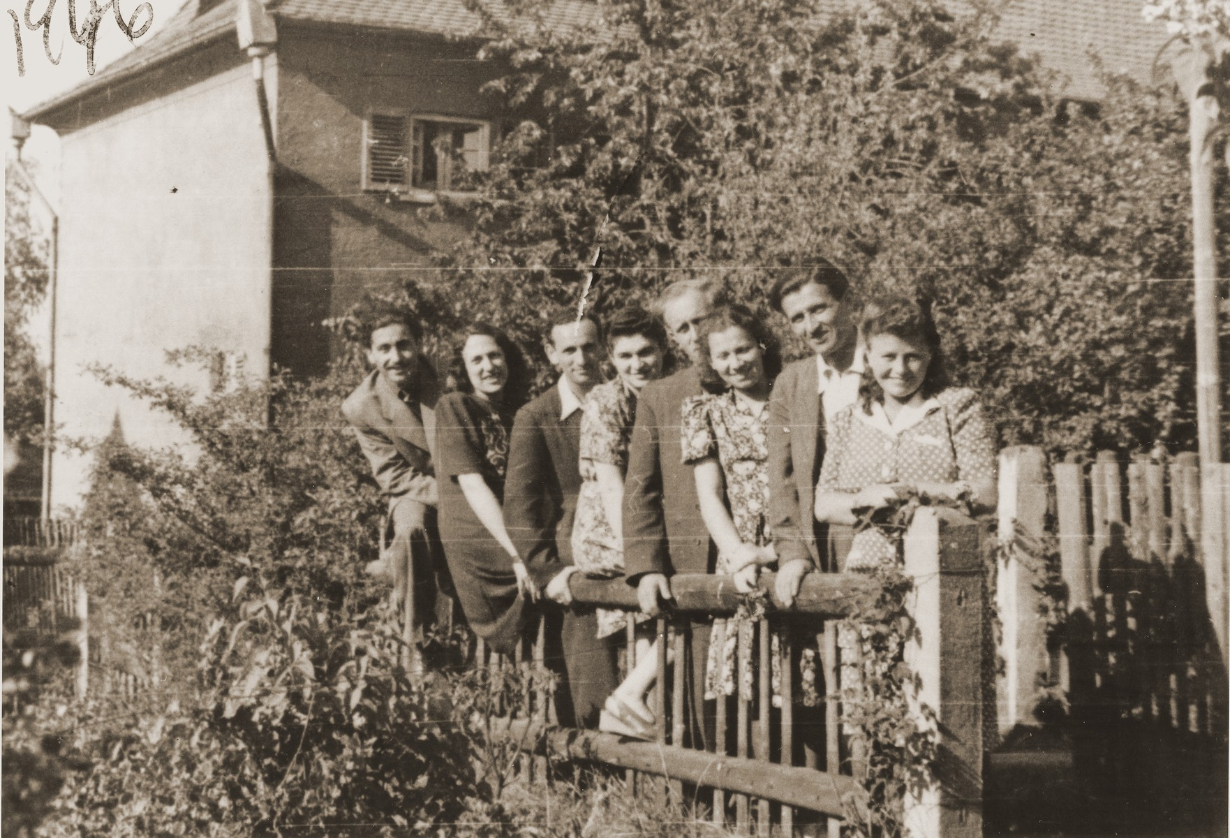 Group portrait of young Jewish couples in the Fuerth displaced persons camp.   Pictured from left to right are: Josef Szrage; Thea Weisman Szrage; Henryk Lanceter; Eugenia (Hochberg) Lanceter; Max Schatz; Ann (Charash) Schatz; Phil (Filo) Batalion; and Fania Batalion.  All of the women but Ann are pregnant.