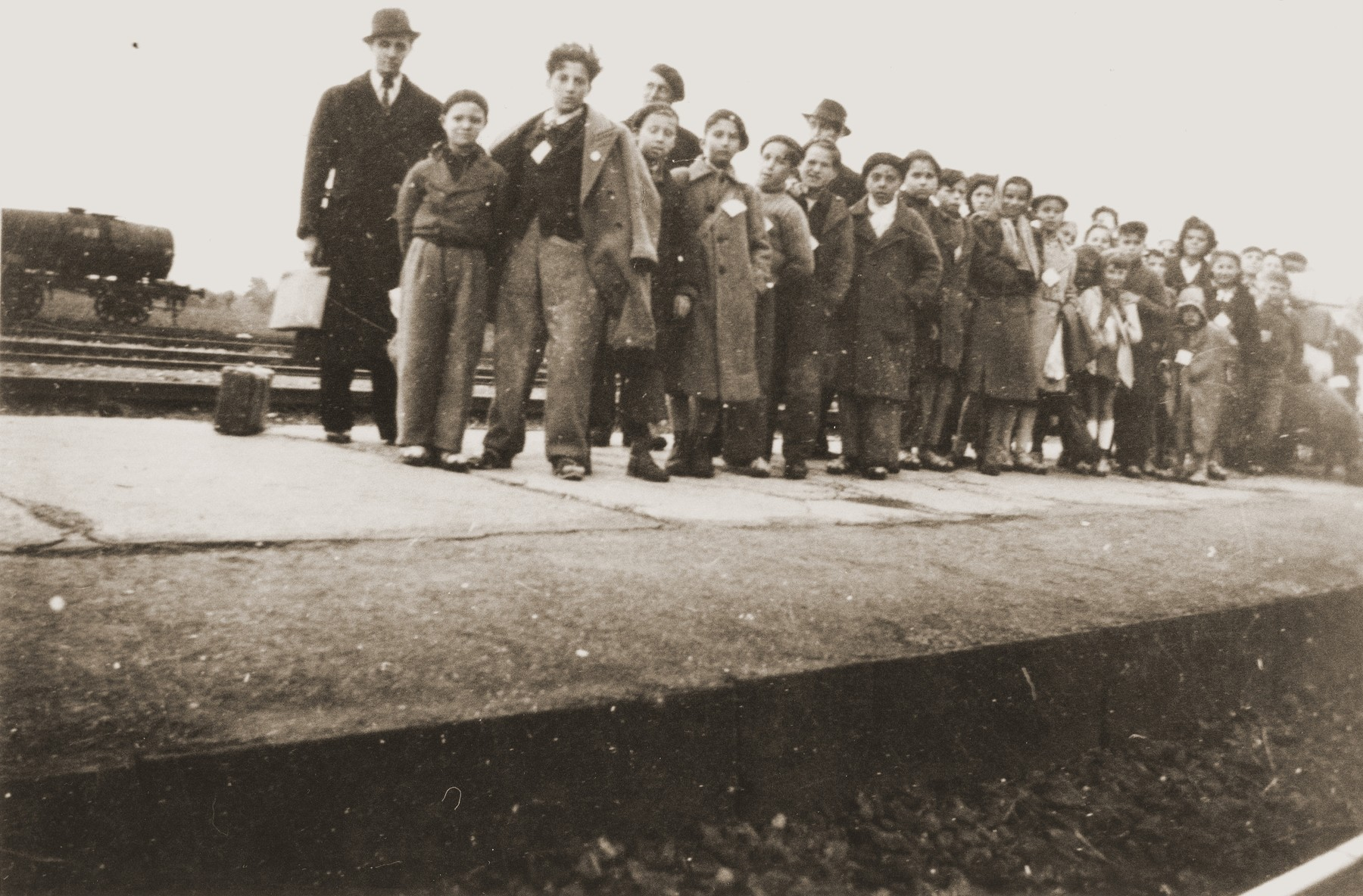 Children released from Rivesaltes wait on the platform of a train station for transport to the Chateau de Montluel children's home near Lyon.
