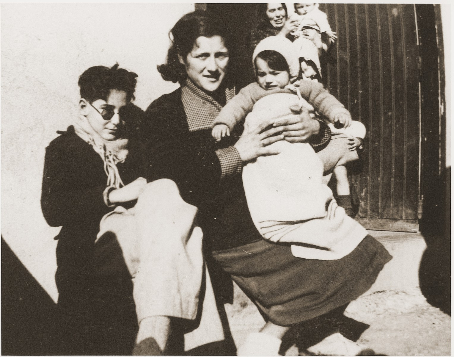 A Spanish family that was injured during the Spanish Civil War sits outside a barracks in the Rivesaltes internment camp.
