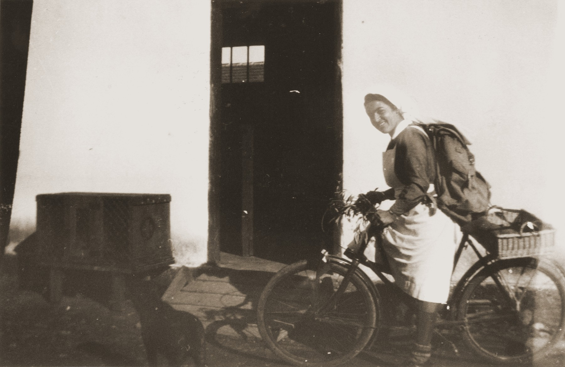Secours Suisse relief worker Friedel Reiter, rides a bicycle in the Rivesaltes internment camp.