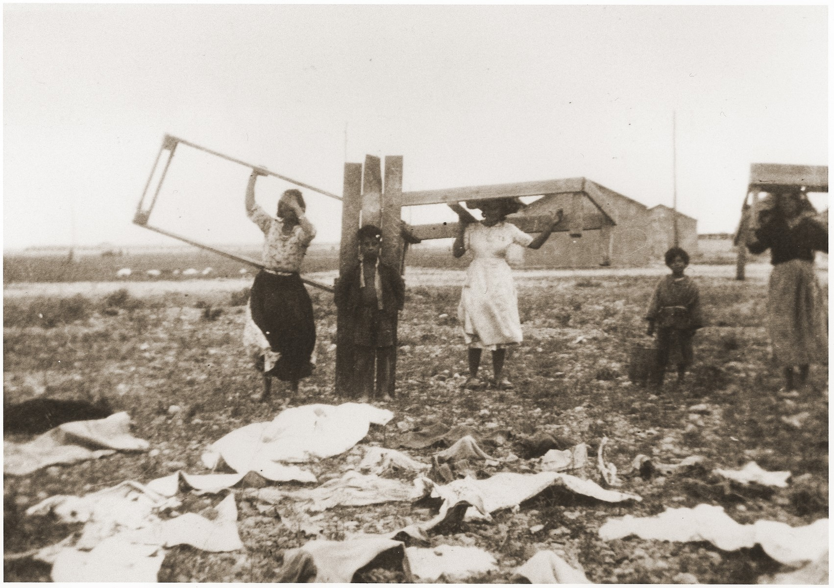 Internees move their bed frames to new quarters in the Rivesaltes internment camp.