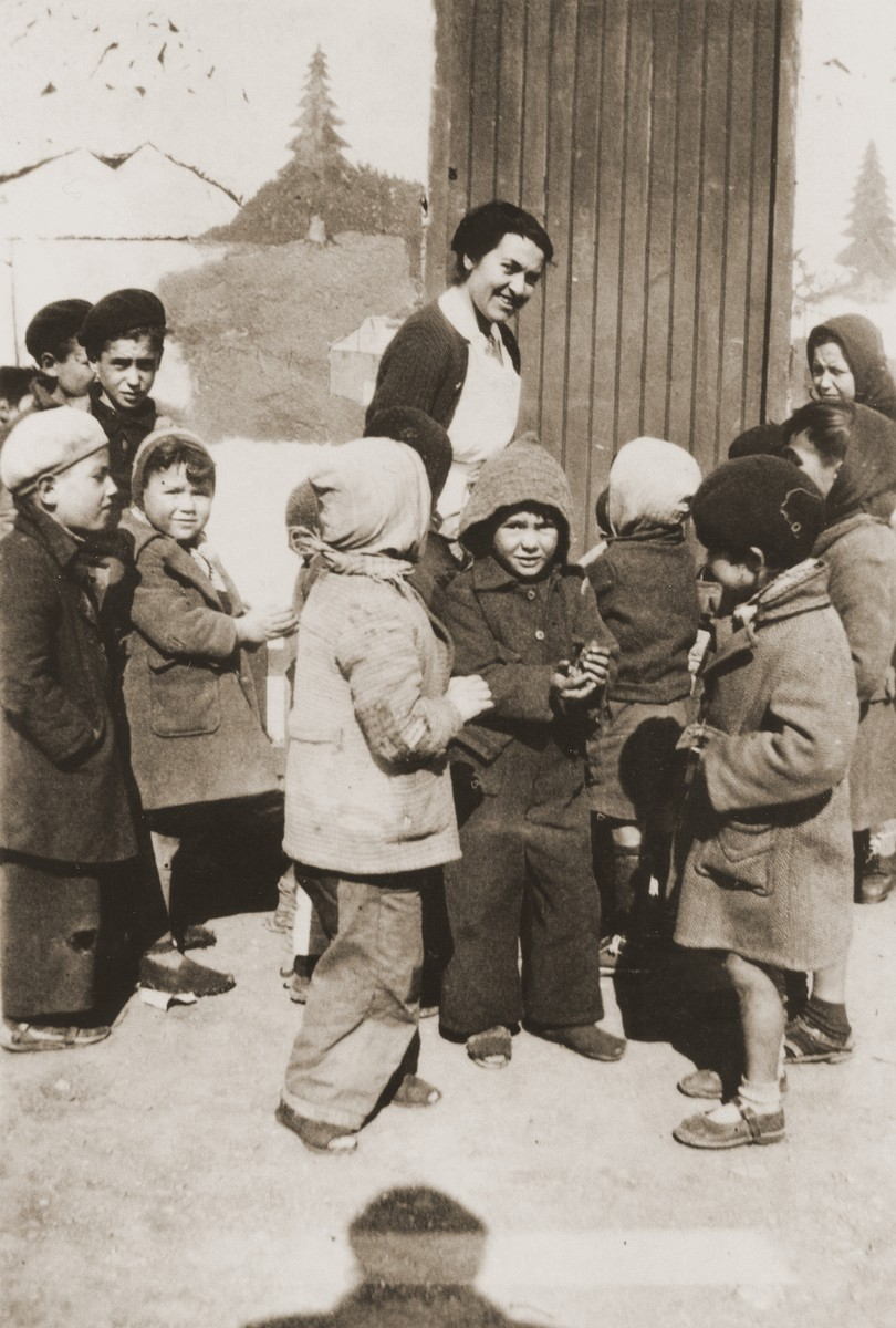 Friedel Reiter greets children as they arrive to the nursery school at the Rivesaltes internment camp.