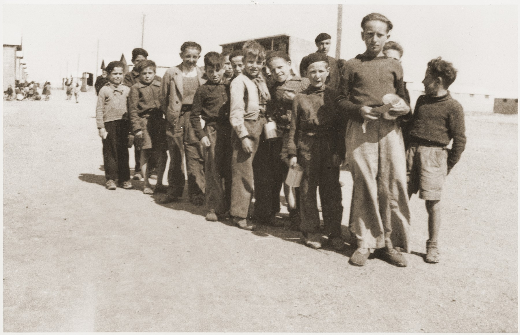 Children in the Rivesaltes transit camp wait for food distribution at the Secours Suisse building.