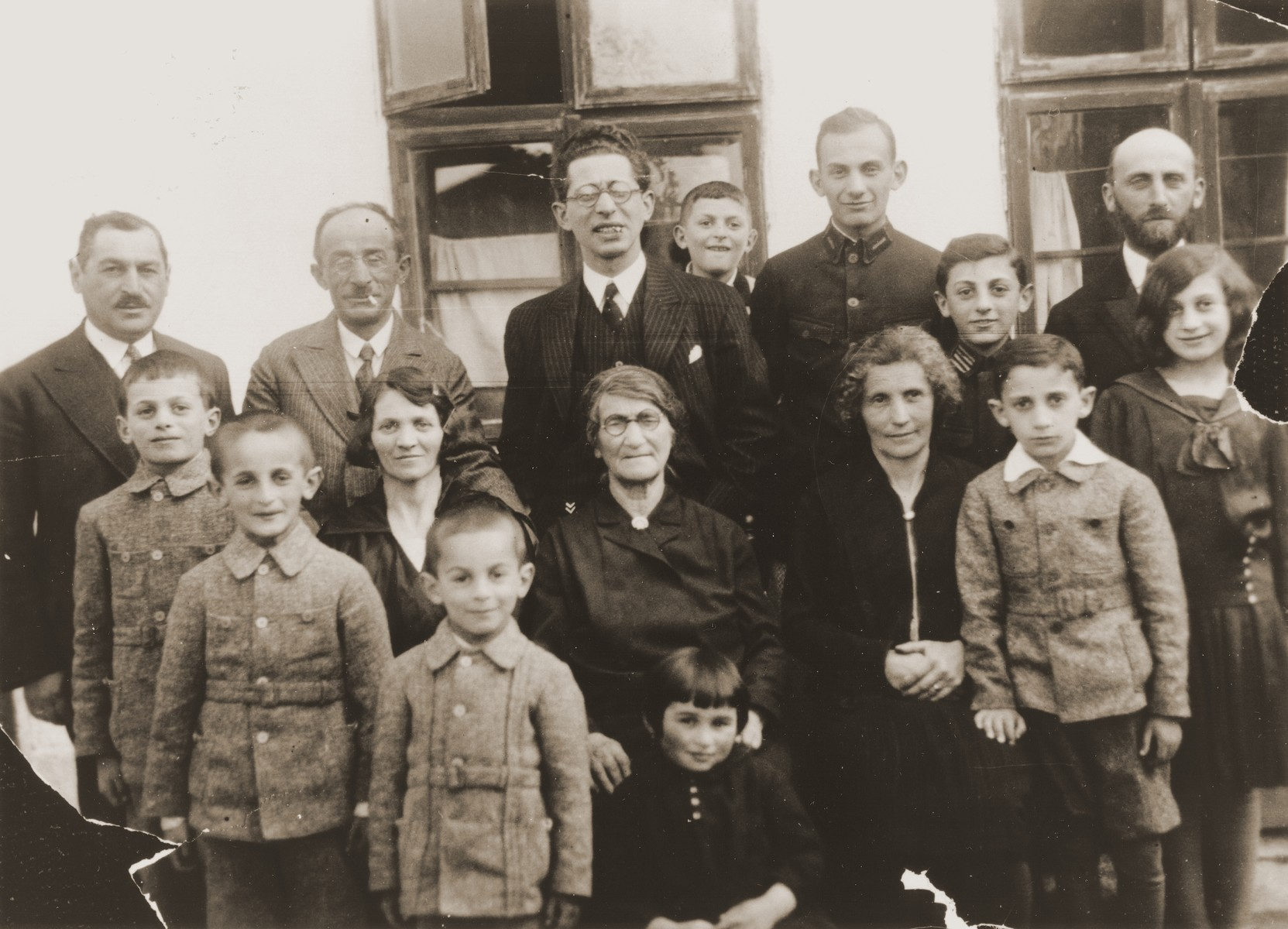 Group portrait of the extended Jewish Hochberg family in Brody, Poland.    Pictured standing in the back row from left to right are: Bernard Hochberg, Gerszon Hochberg (the donor's uncle), Marco Chaim Lifschitz (the donor's uncle), Sigmund Hochberg, Sonio and Itamar Katz (the donor's cousins), Efraim Katz (Sonio and Itamar's father and the donor's uncle). In the middle row, left to right, are: Itamar Lifschitz; Chaja (Hochberg) Lifschitz (the wife of Gerszon Hochberg), Batja (Lifschitz) Hochberg (the donor's grandmother), Malka (Hochberg) Katz (the donor' aunt), Abram Katz, and Rachel Katz.  In the front row,  from left to right, are Arie Lifschitz, Szaja Lifschitz, and Eugenia Hochberg.