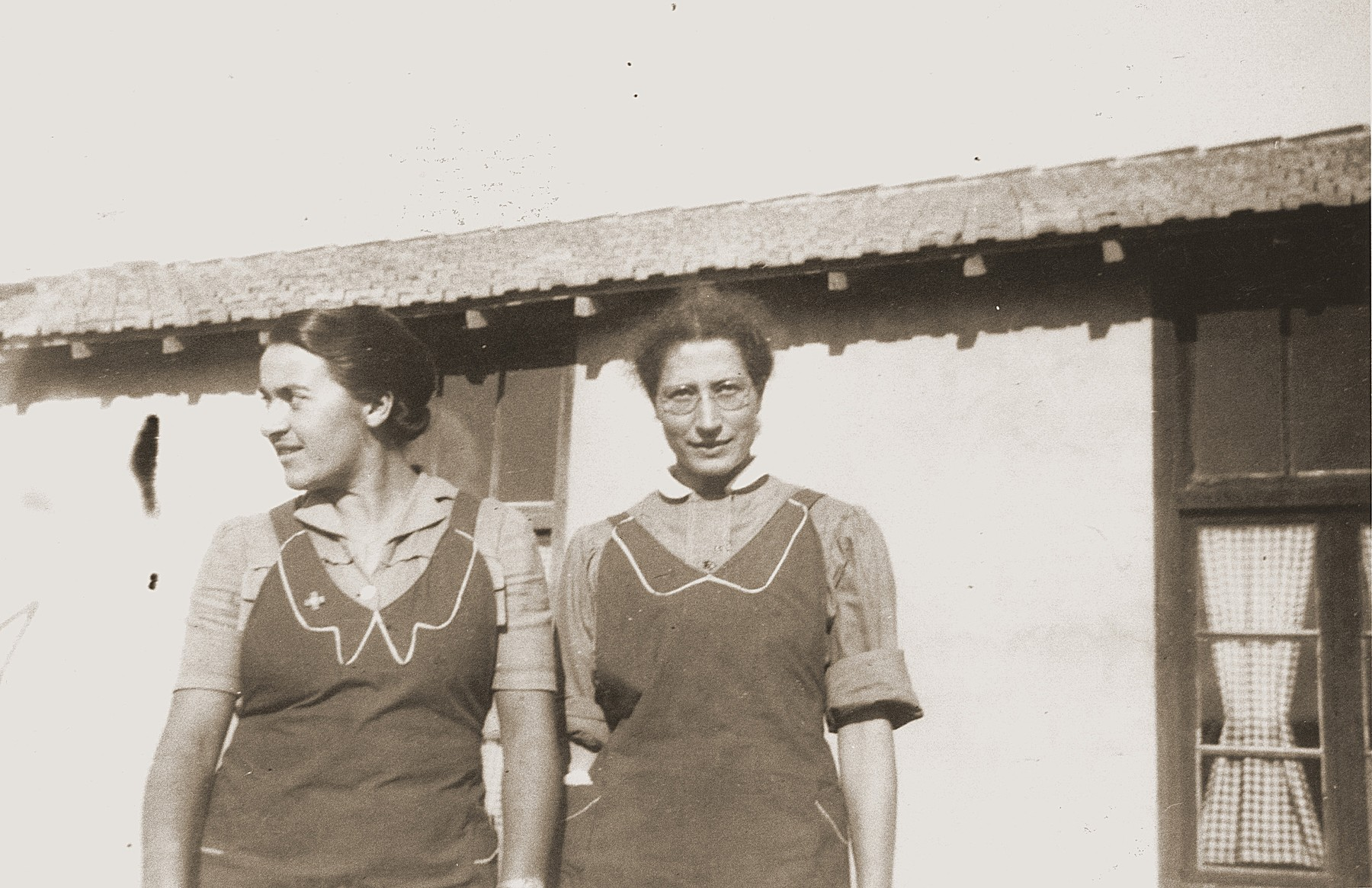 Secours Suisse relief workers Friedel Reiter (left) and Heidi Stierlin stand outside a barracks at the Rivesaltes internment camp.