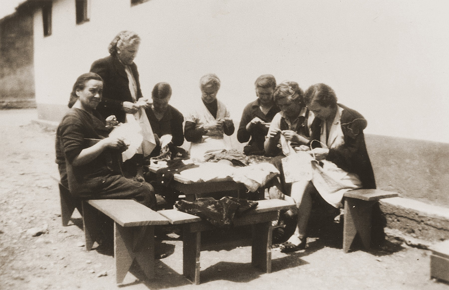 A group of Spanish women sew outside a barracks in the Rivesaltes internment camp.