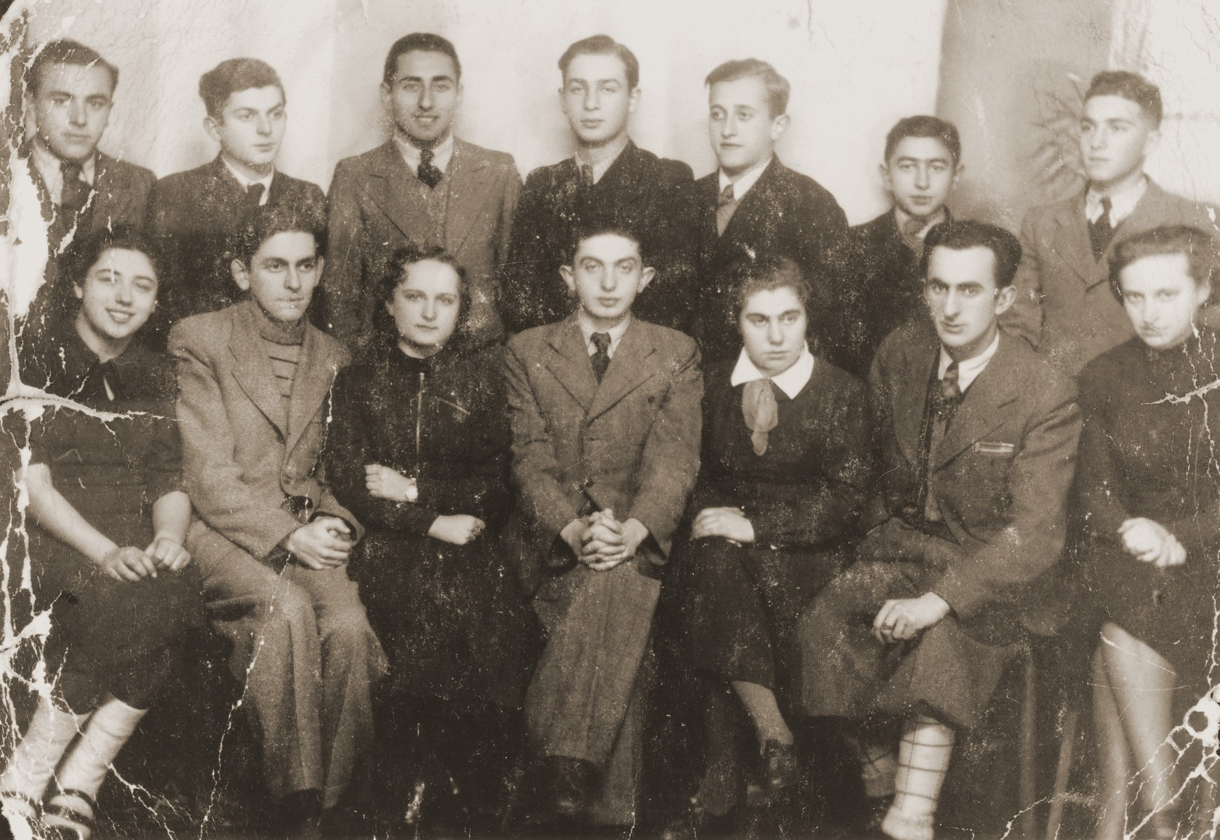 Group portrait of members of the Achvah Akademicka Jewish student organization in Brody, Poland.  Pictured in the top row, left to right, are: Jacob Tomaszower; Sigmund Hochberg; Mr. Klepper; Jonah Zuckerman; Olek Mollet; Julius Langerwitz; and Munio Pfeffer. Seated in the front row, left to right, are: Syda Broczyner; Mr. Striecher; Blanka Levin; unknown; Bianka Lillian; unknown; and unknown.