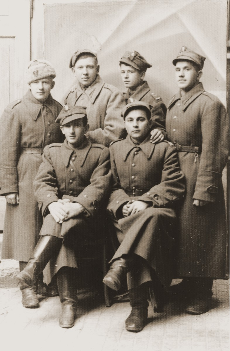 Group portrait of soldiers in the Polish Berling Army.   Among those pictured is the Jewish soldier Henryk Lanceter (seated on the left).