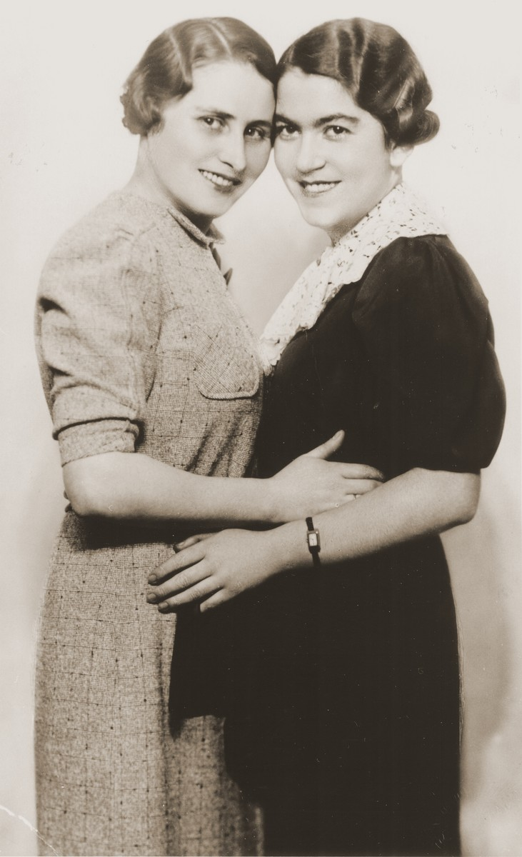 Studio portrait of two young Jewish women.  Pictured are Czeslava (Harmelin) Sauber (left) and Toni (Auerbach) Zimon.  Both are aunts of the donor.