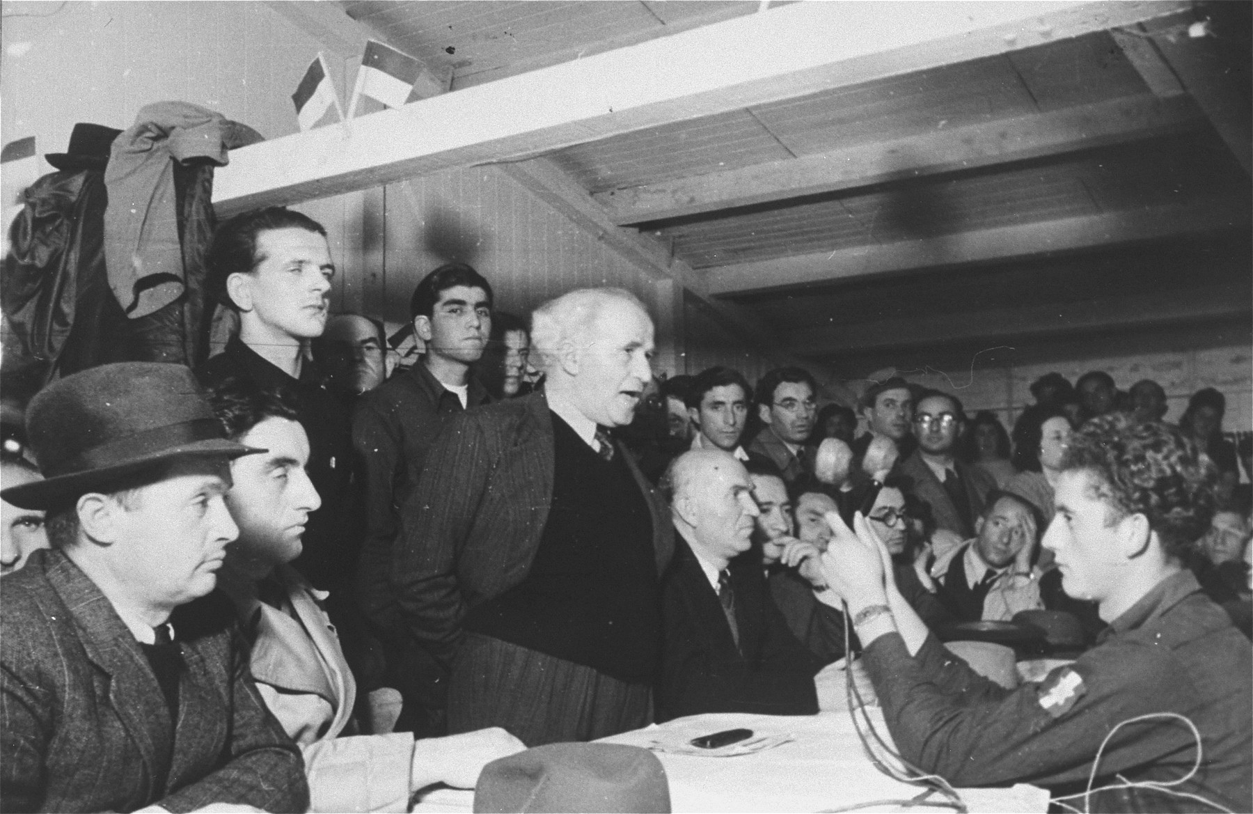 David Ben-Gurion, Chairman of the Jewish Agency Executive, delivers a speech at a public forum during an official visit to the Zeilsheim displaced persons camp.