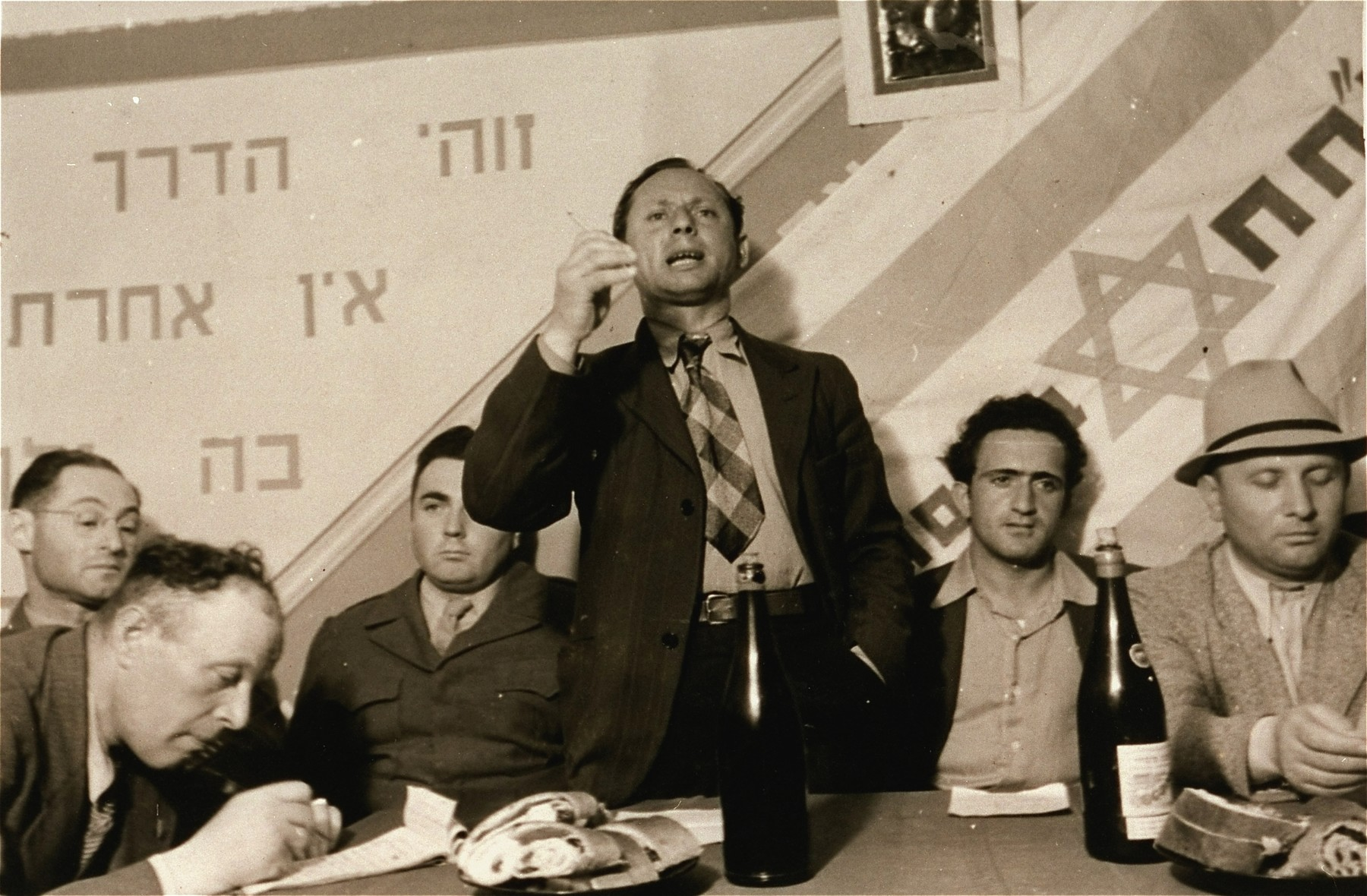 An unidentified man addresses the audience in a P.H.H. Zionist political meeting in the Zeilsheim displaced persons' camp.