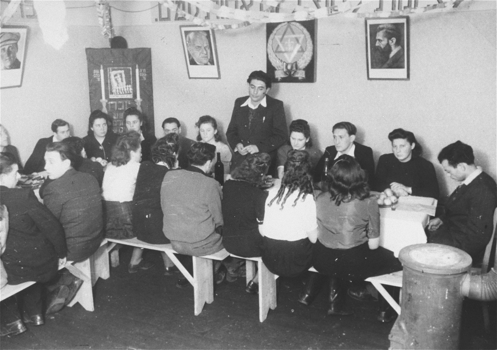 Meeting of a Zionist youth organization in the Zeilsheim displaced persons' camp.  Pictured in the back row, third from the left is Sheyne-Bela Burke (Propis).  She is the sister of Berl  Berk, who was killed in the Kovno ghetto along with 426 intellectuals.