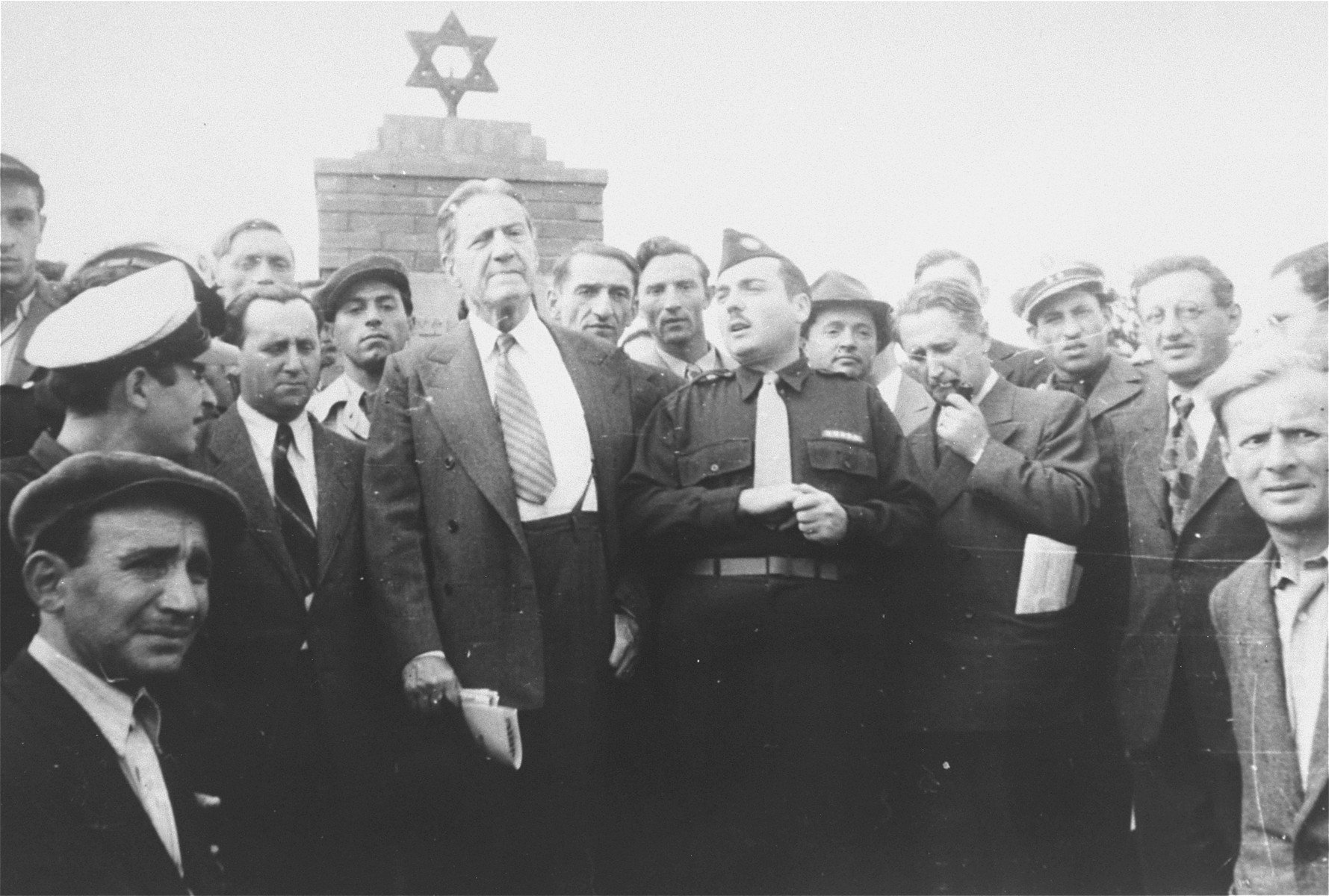 Rabbi Stephen Wise visits the Zeilsheim displaced persons camp.   Among those pictured is Abe Greenberg (far right, front).