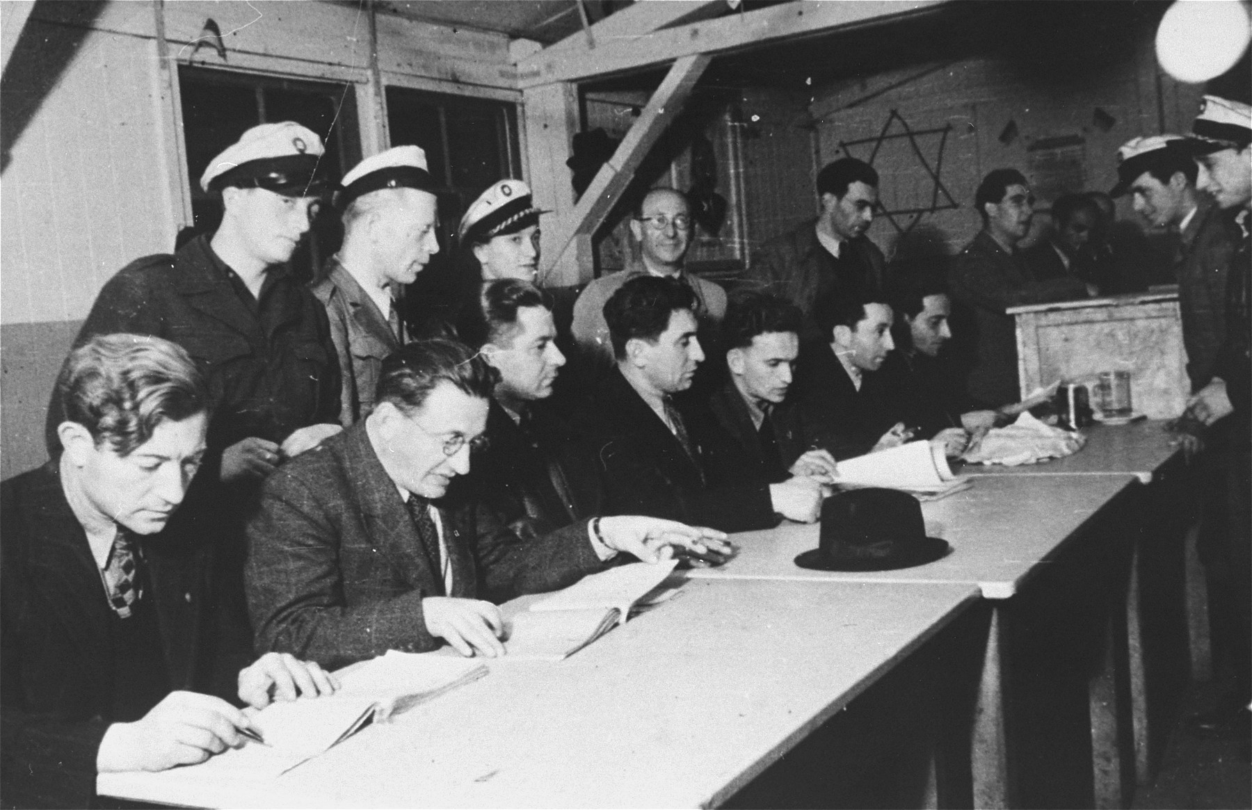 Jewish police supervise the work of the electing committee during elections in the Zeilsheim displaced persons' camp.