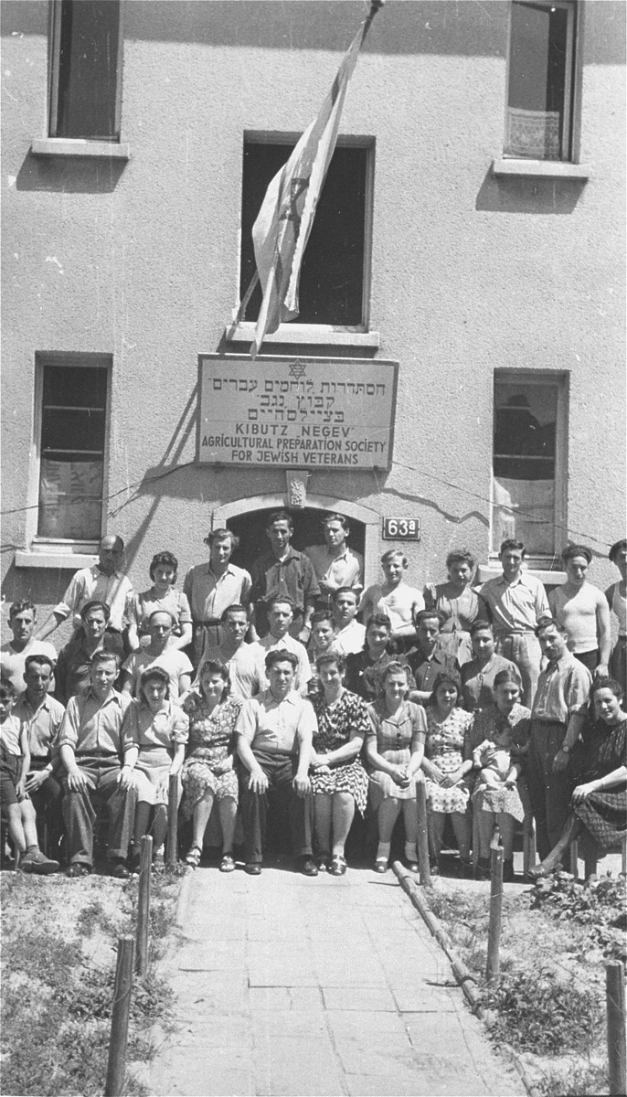 Group portrait of members of the hachshara [agricultural training farm], Kibbutz Negev, in the Zeilsheim displaced persons' camp.