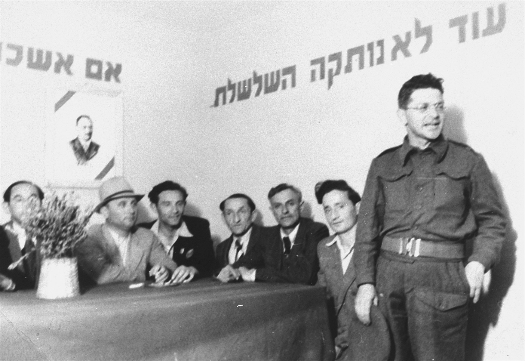 An unidentified man addresses the audience in a Zionist meeting in the Zeilsheim displaced persons' camp.