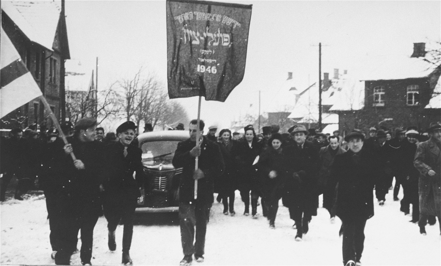 Members of the Poale Zion Left Zionist youth movement participate in a march in the Zeilsheim displaced persons camp.