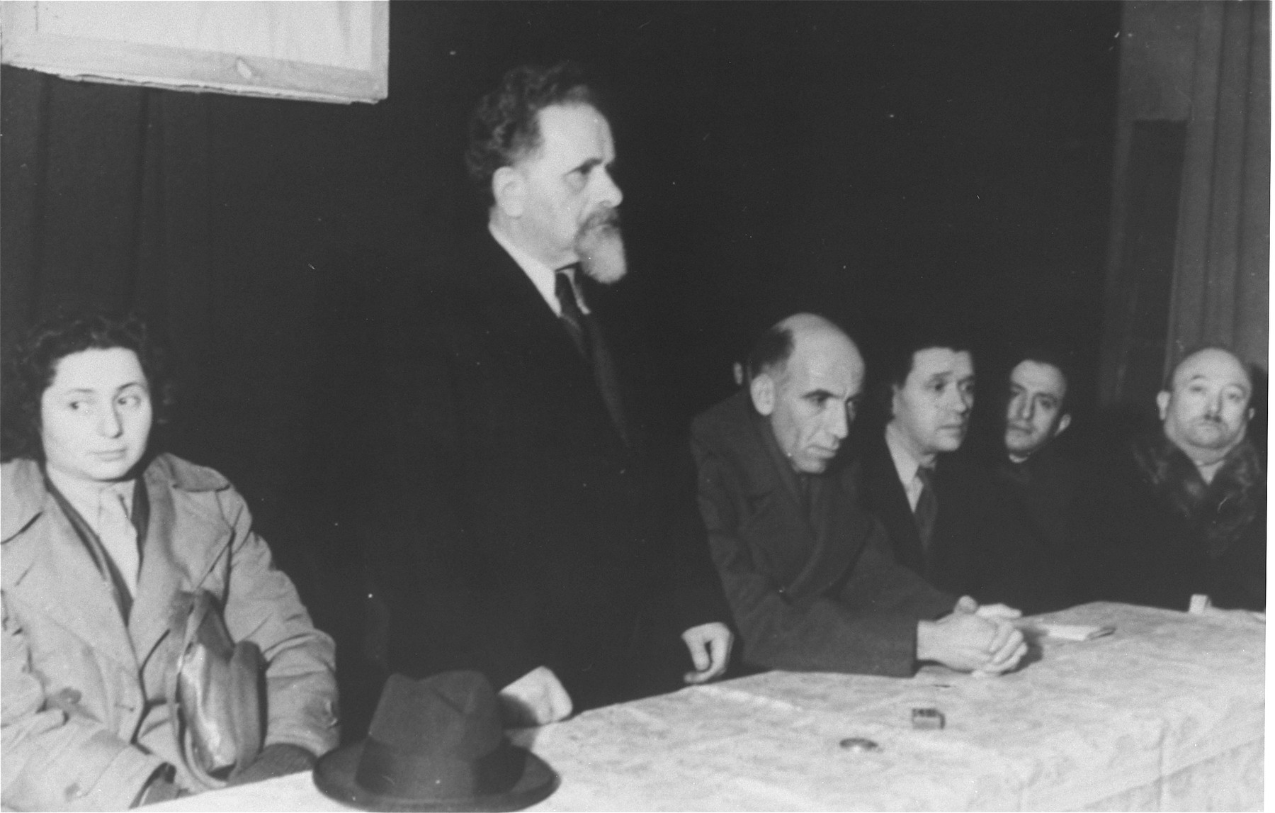 Yitzhak Gruenbaum delivers a speech at a Zionist meeting during his visit to the Zeilsheim displaced persons camp.