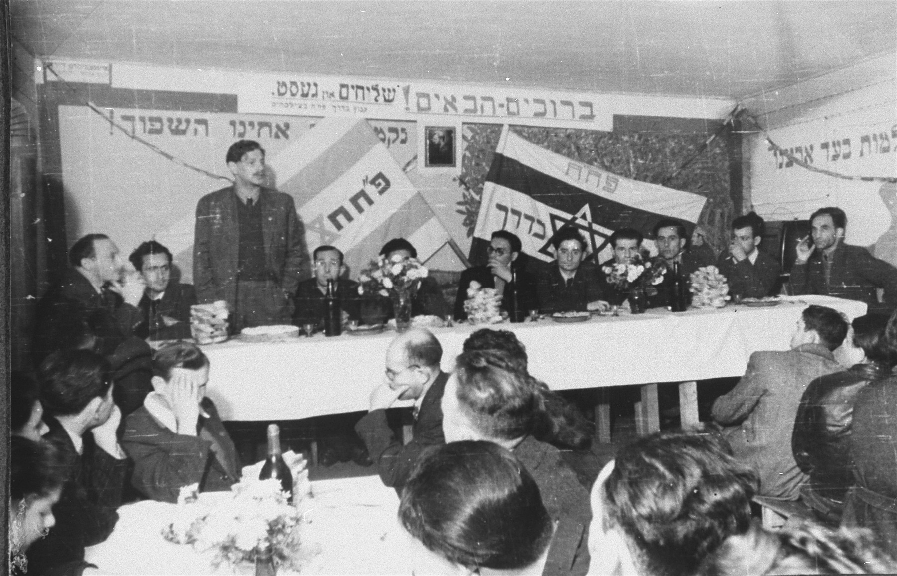 Yitzhak Zuckerman delivers a speech at a Zionist political meeting in the Zeilsheim displaced persons' camp.