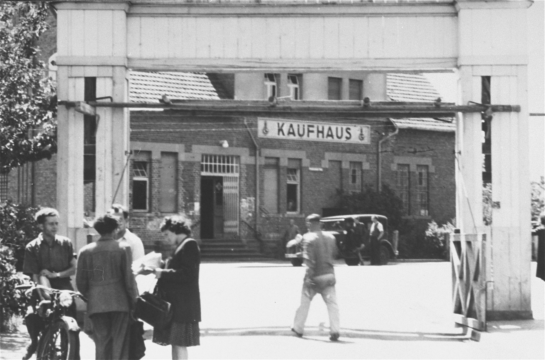 Street scene in front of the Kaufhaus [department store] in the Zeilsheim displaced persons' camp.