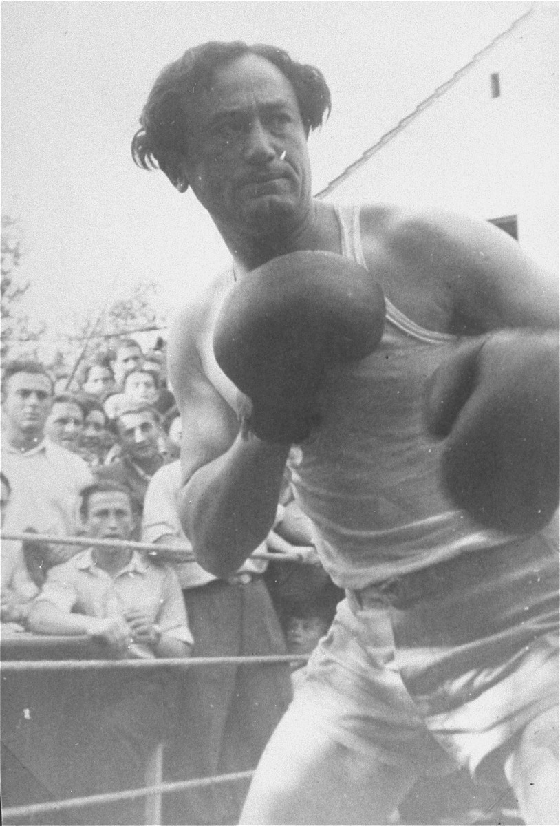 Close-up of a boxer in the ring at a match at the Zeilsheim displaced persons' camp.