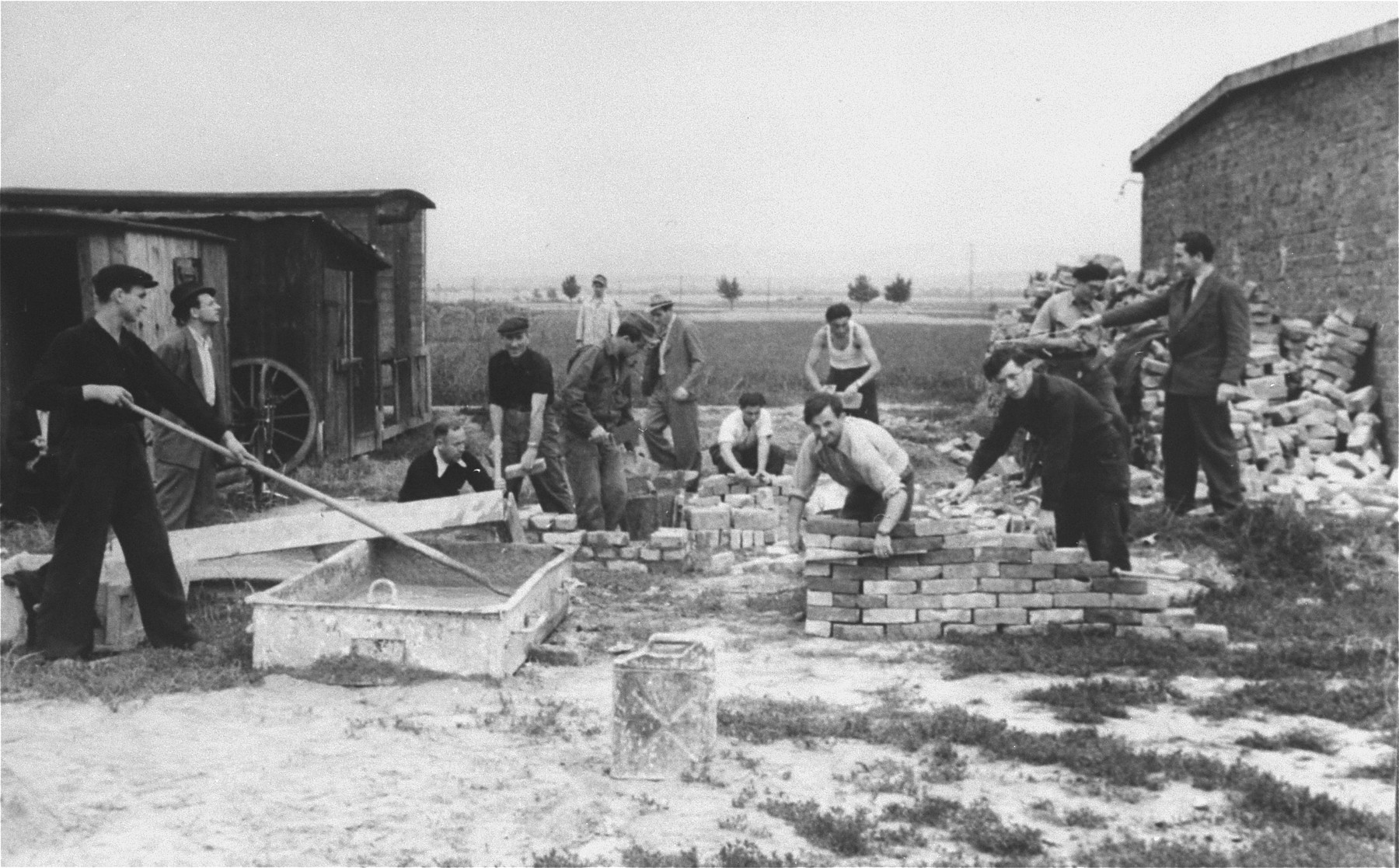 Men construct a brick wall in an ORT sponsored vocational school in the Zeilsheim displaced persons' camp.