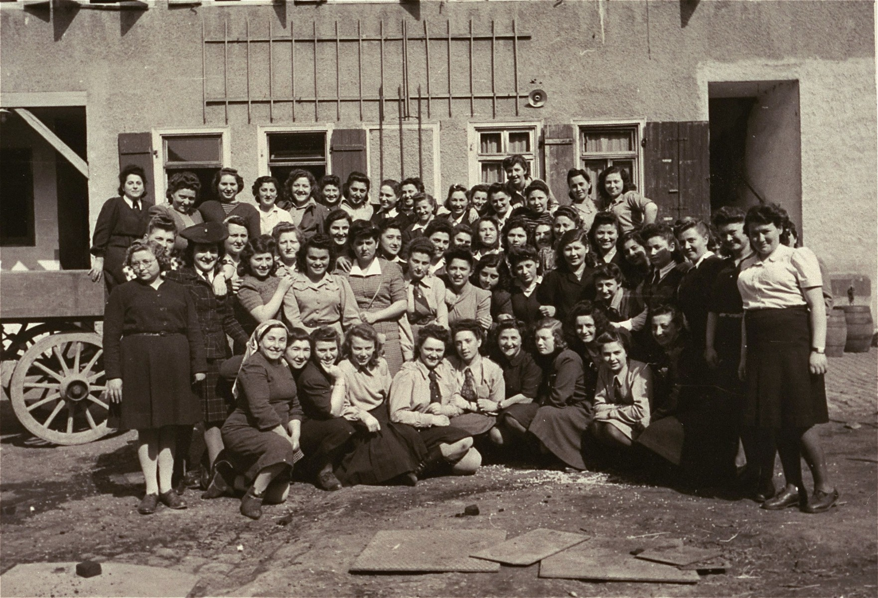 "Group portrait of members of the hachshara kibbutz [agricultural training farm] ""Kibbutz Negev"" in the Zeilsheim displaced person's camp."