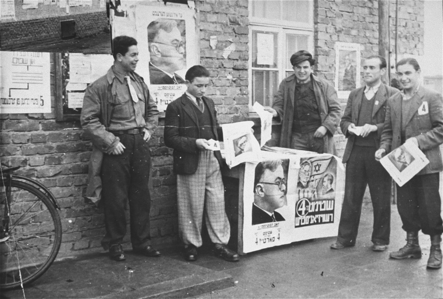 Election committee members distribute campaign posters in the Zeilsheim displaced persons' camp.