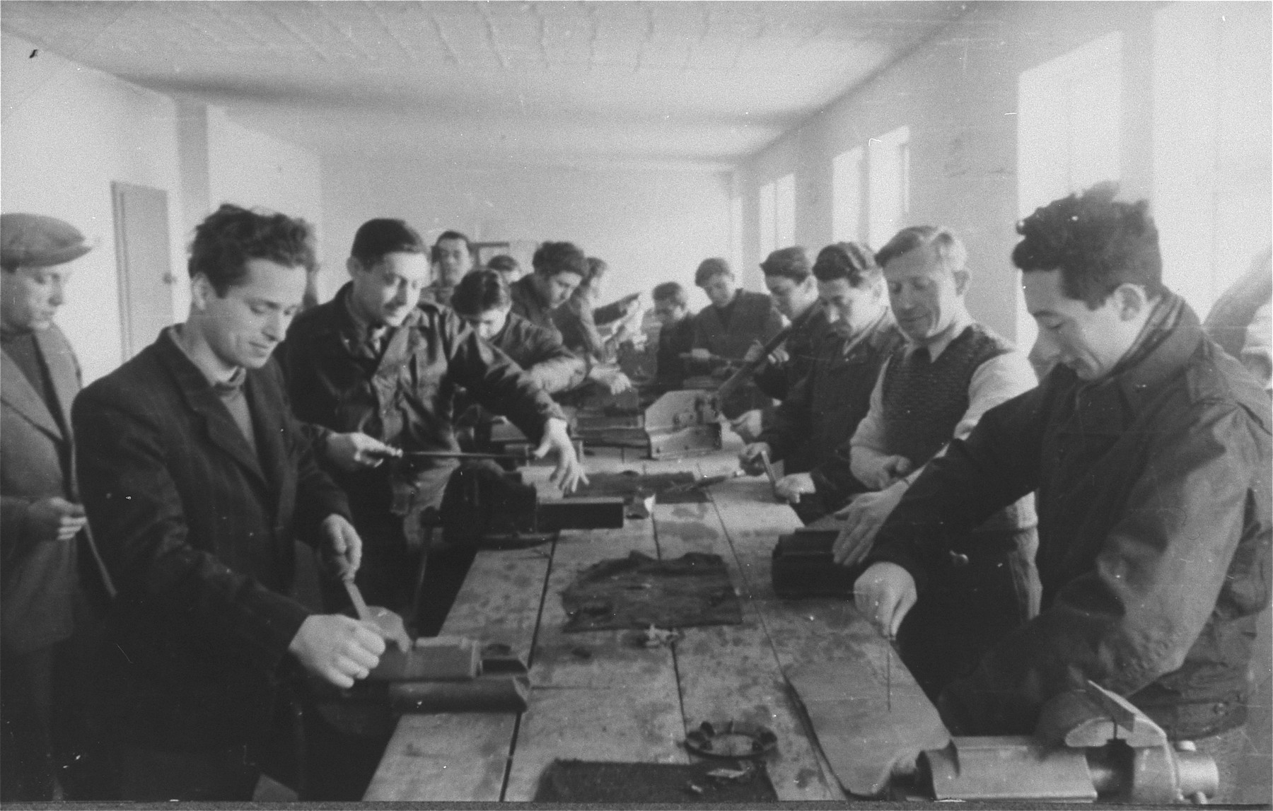 A goup of men practice carpentry in an ORT vocational school in the Zeilsheim displaced persons' camp.