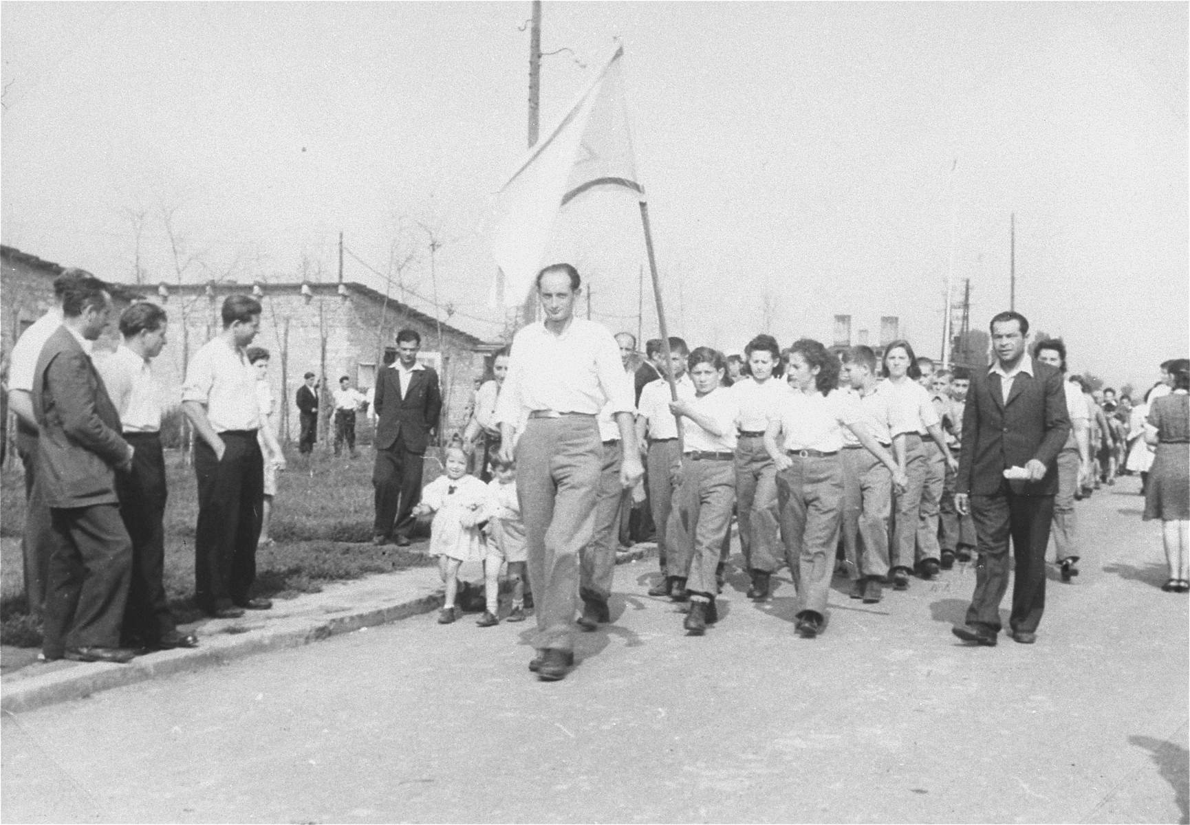 Zionist youth march with flags in a procession at the Zeilsheim displaced persons' camp.