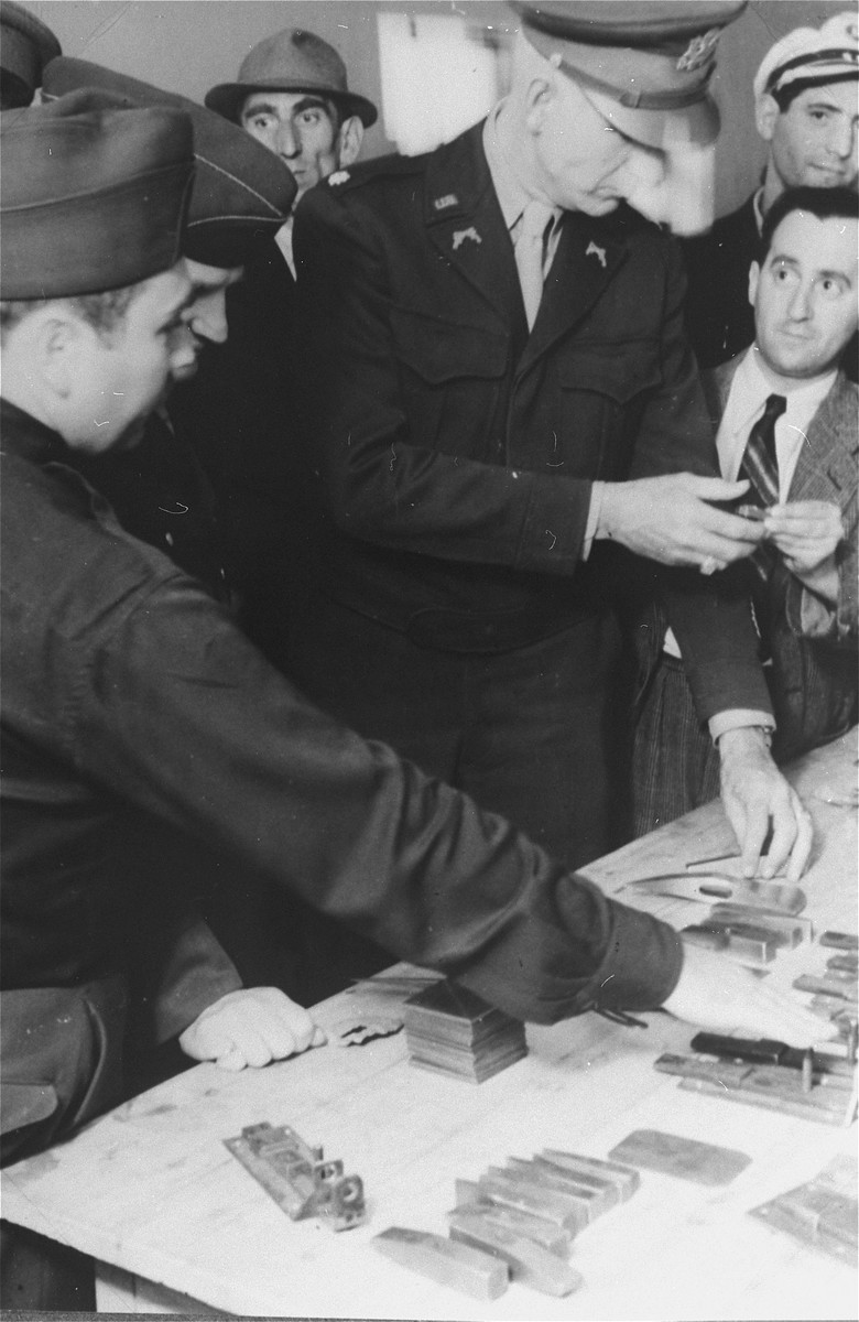 US army personnel inquire about the vocational training during an official visit to the Zeilsheim displaced persons' camp.