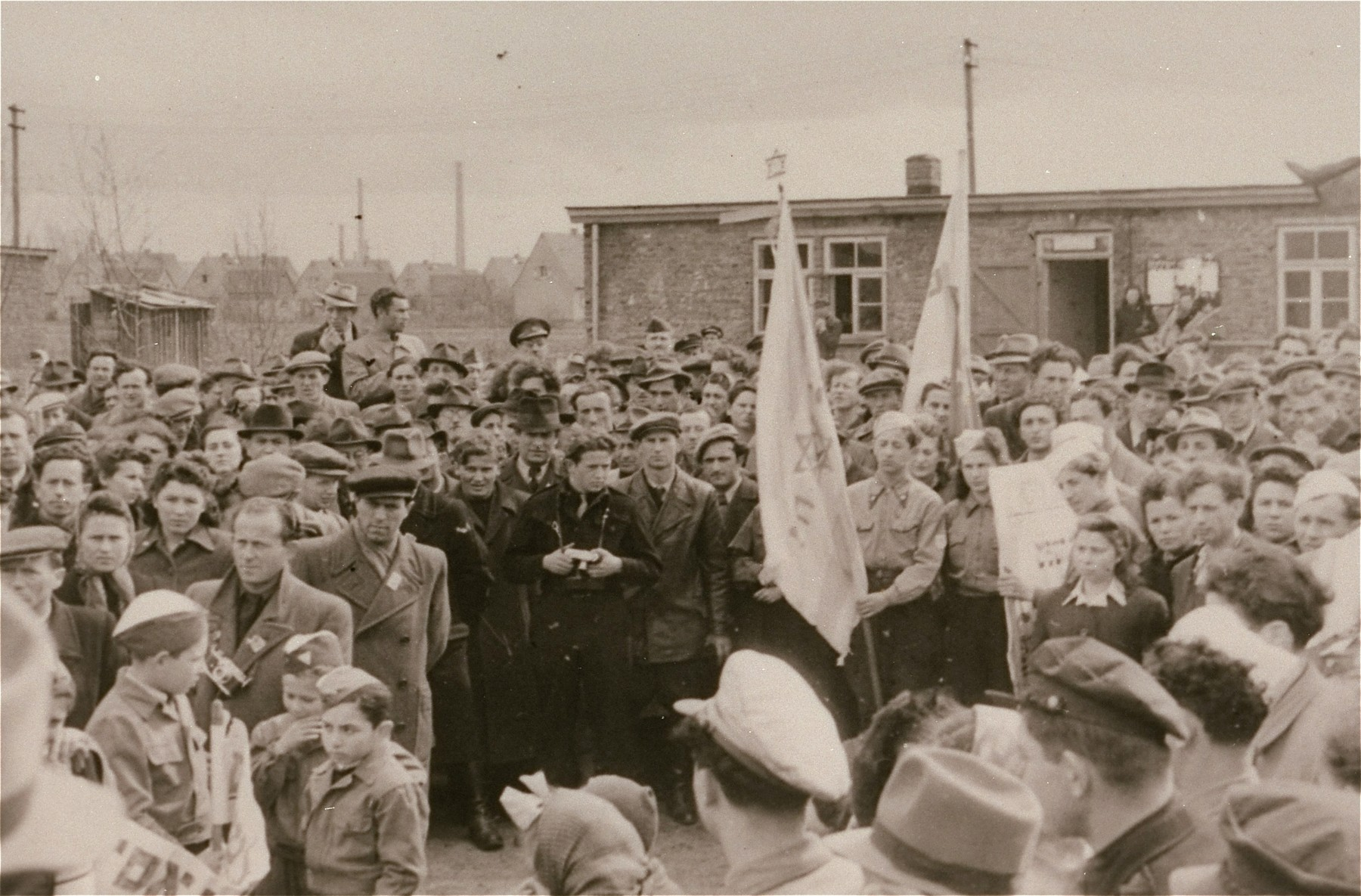 Jewish DPs at the Zeilsheim displaced persons camp hold a rally to promote free immigration to Palestine.