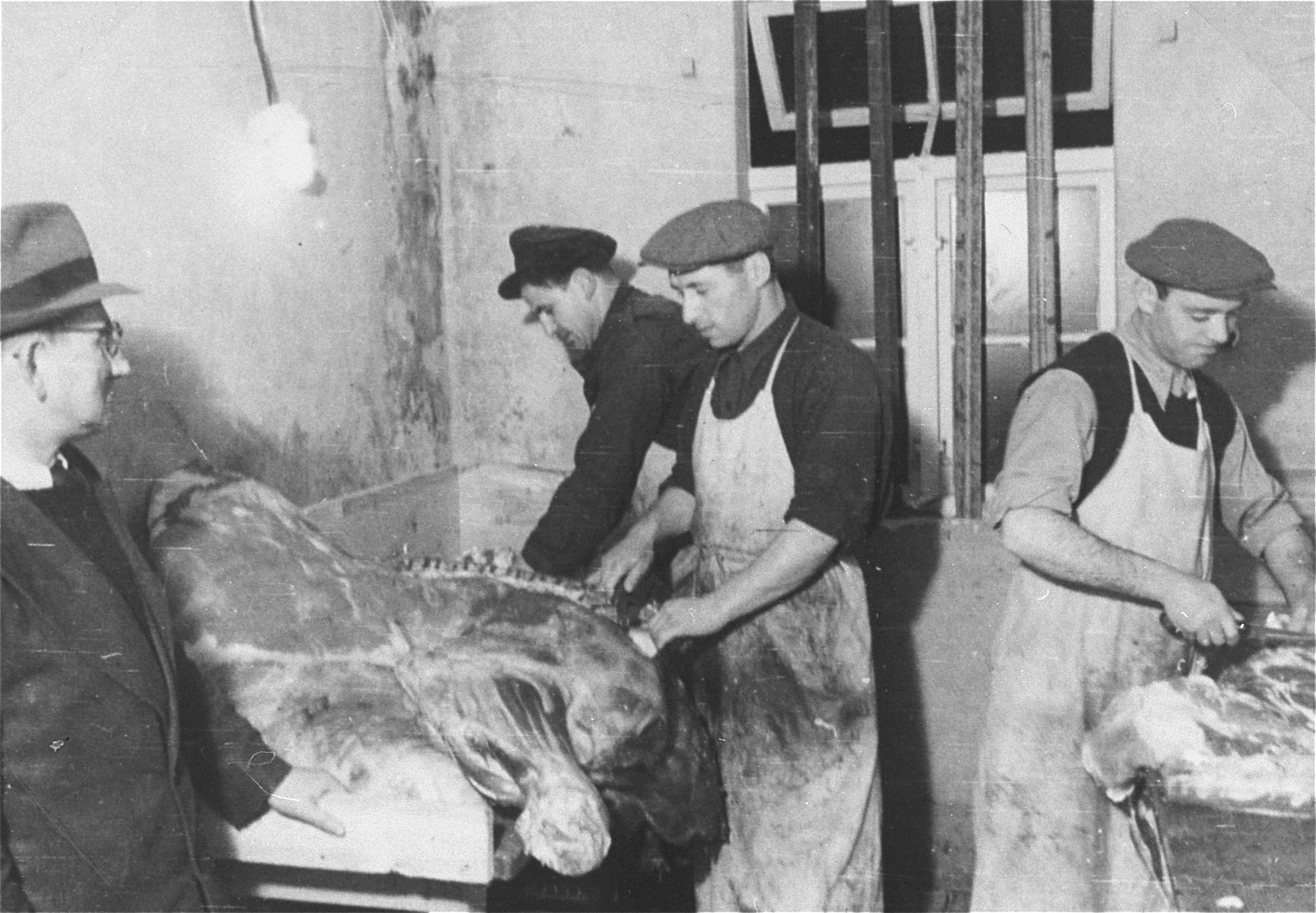 Butchers carve meat in the Zeilsheim displaced persons' camp.