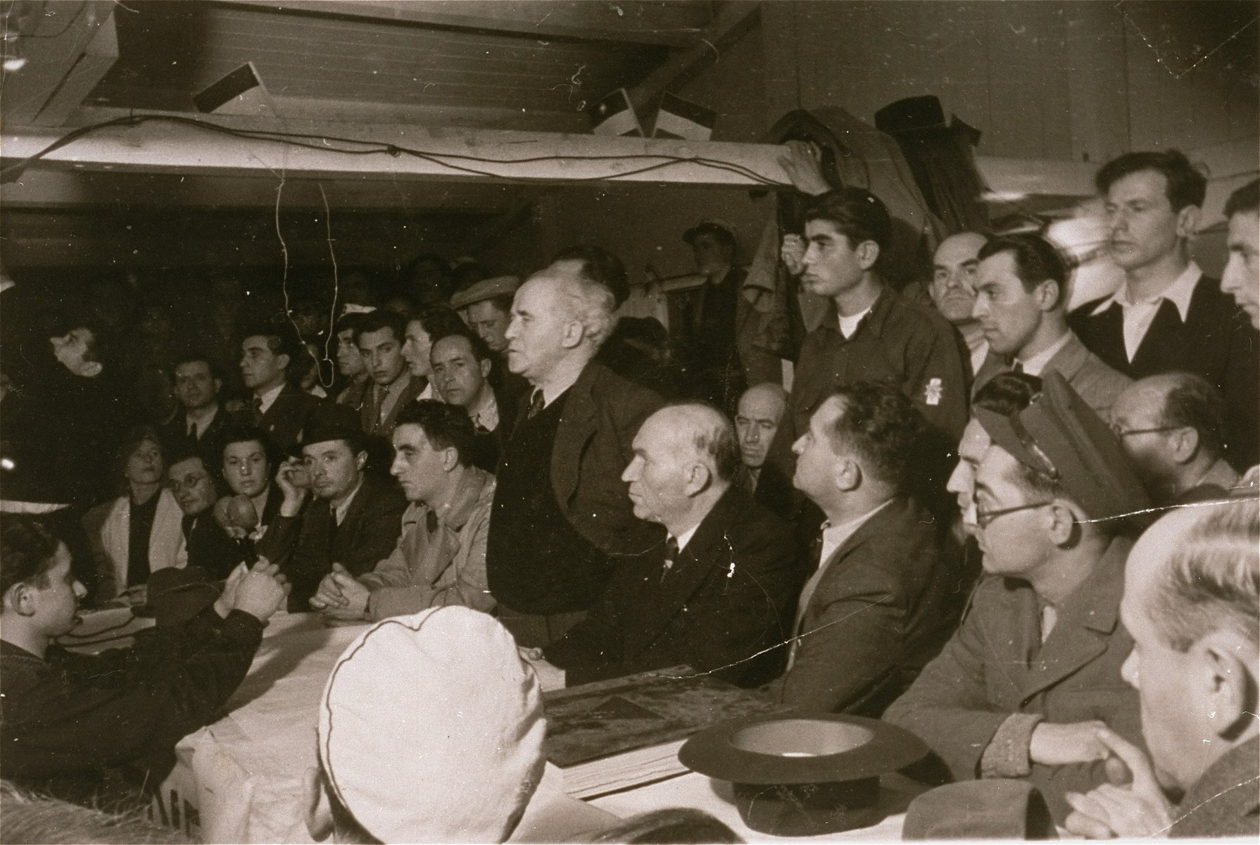 David Ben-Gurion, Chairman of the Jewish Agency, attends a public meeting during his visit to Zeilsheim displaced persons camp.