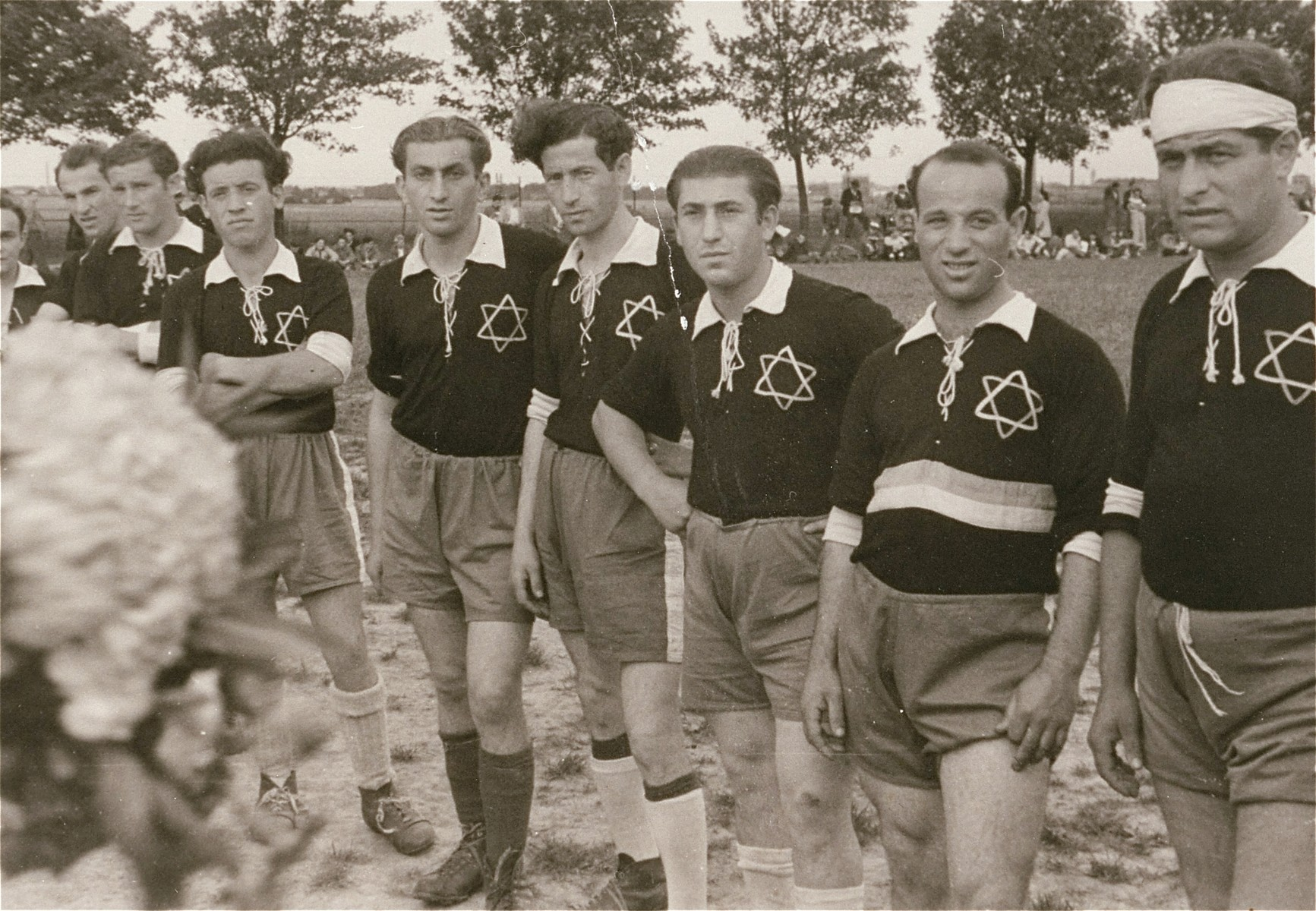 Group portrait of a Jewish DP soccer team during a sporting event at the Zeilsheim displaced persons camp.