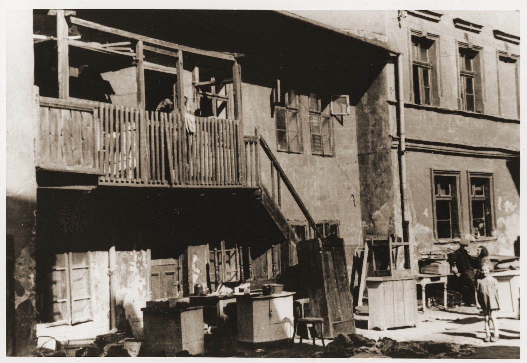 Household furnishings line the courtyard outside Jewish homes in the ghetto.
