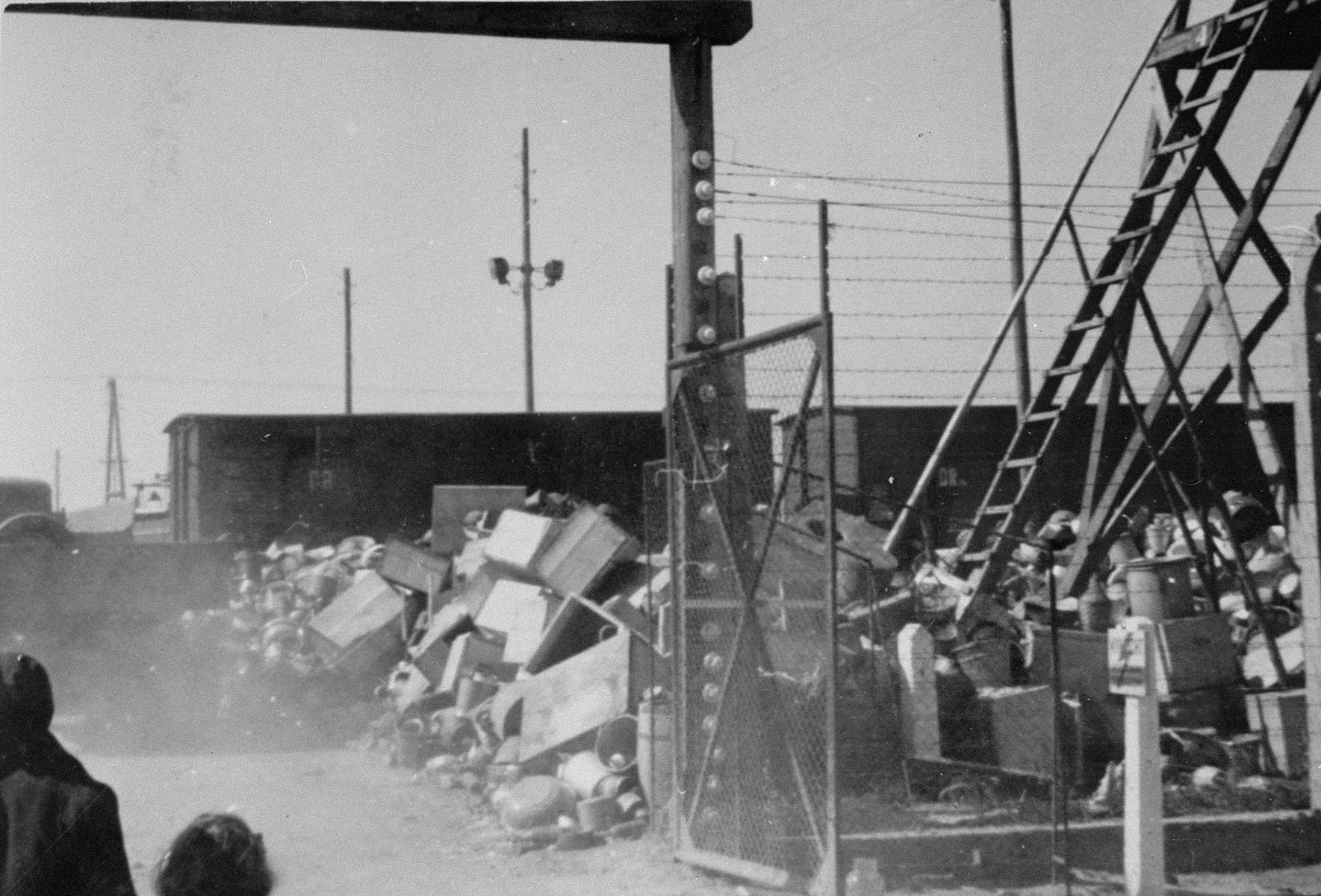"View of a mound of confiscated personal property from an arriving transport of Jews from Subcarpathian Rus.   The camp prisoners came to refer to the looted property as ""Canada,"" associating it with the riches symbolized by Canada.  The members of this commando were almost exclusively Jews.  ""Canada"" storage facilities occupied several dozen barracks and other buildings around the camp.  The looted property was funneled from Auschwitz through an extensive distribution network that served many individuals and various economic branches of the Third Reich."