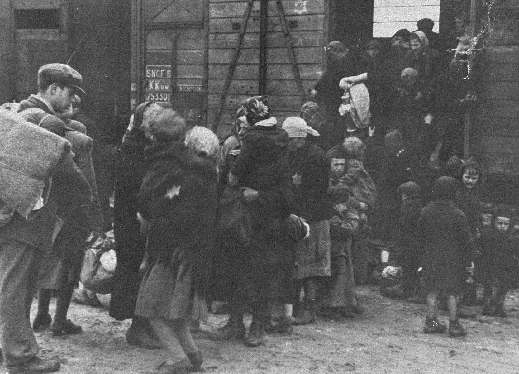 Newly arrived Jews from Subcarpathian Rus get off the train in Auschwitz-Birkenau.