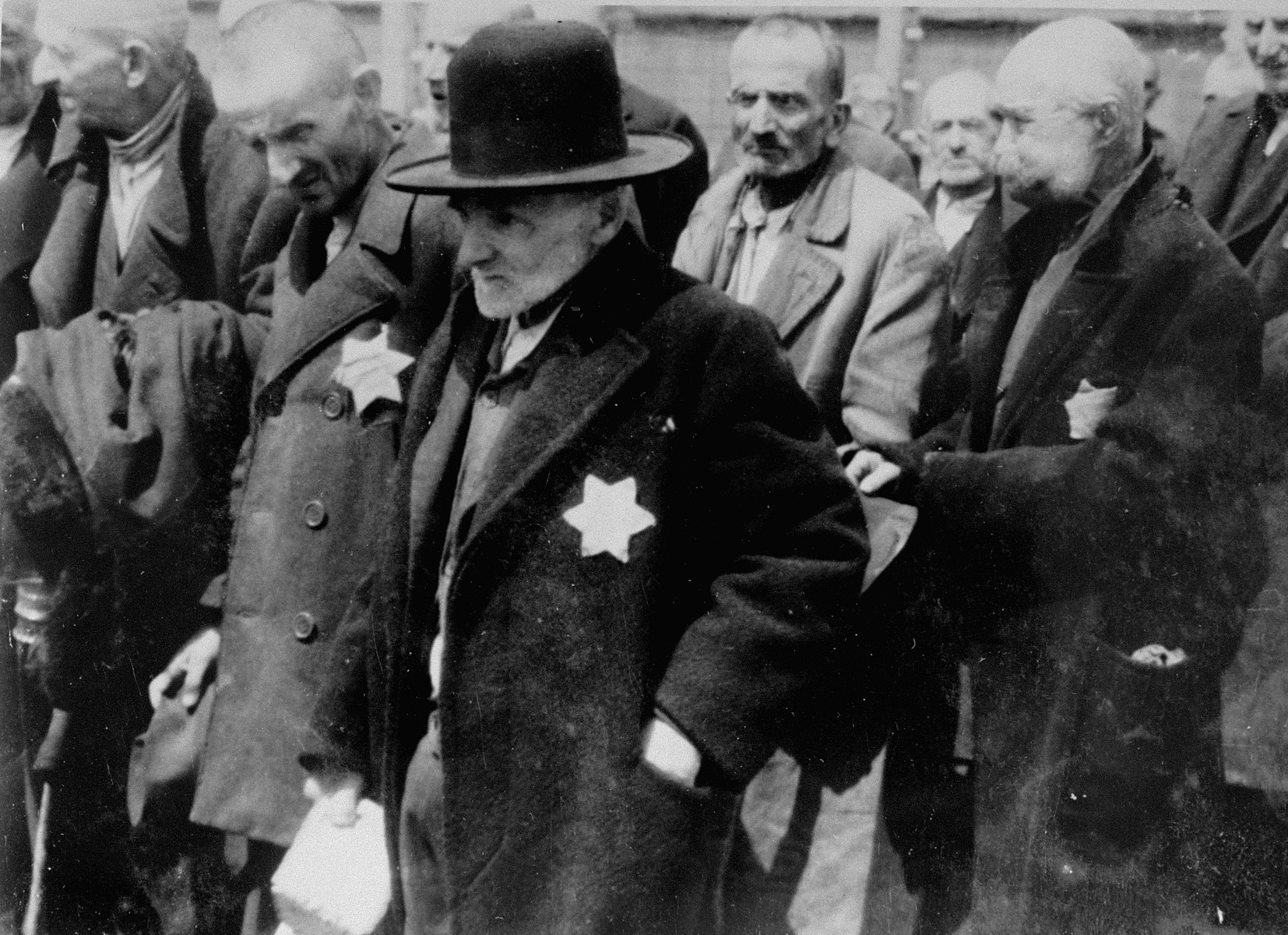 Jewish men from Subcarpathian Rus having undergone selection are about to be gassed at Auschwitz-Birkenau.