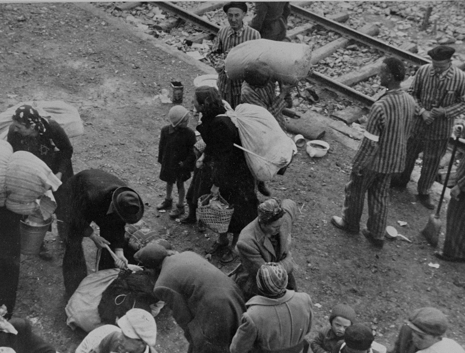 New arrivals to Auschwitz from Subcarpathian Rus attend to their personal belongings.