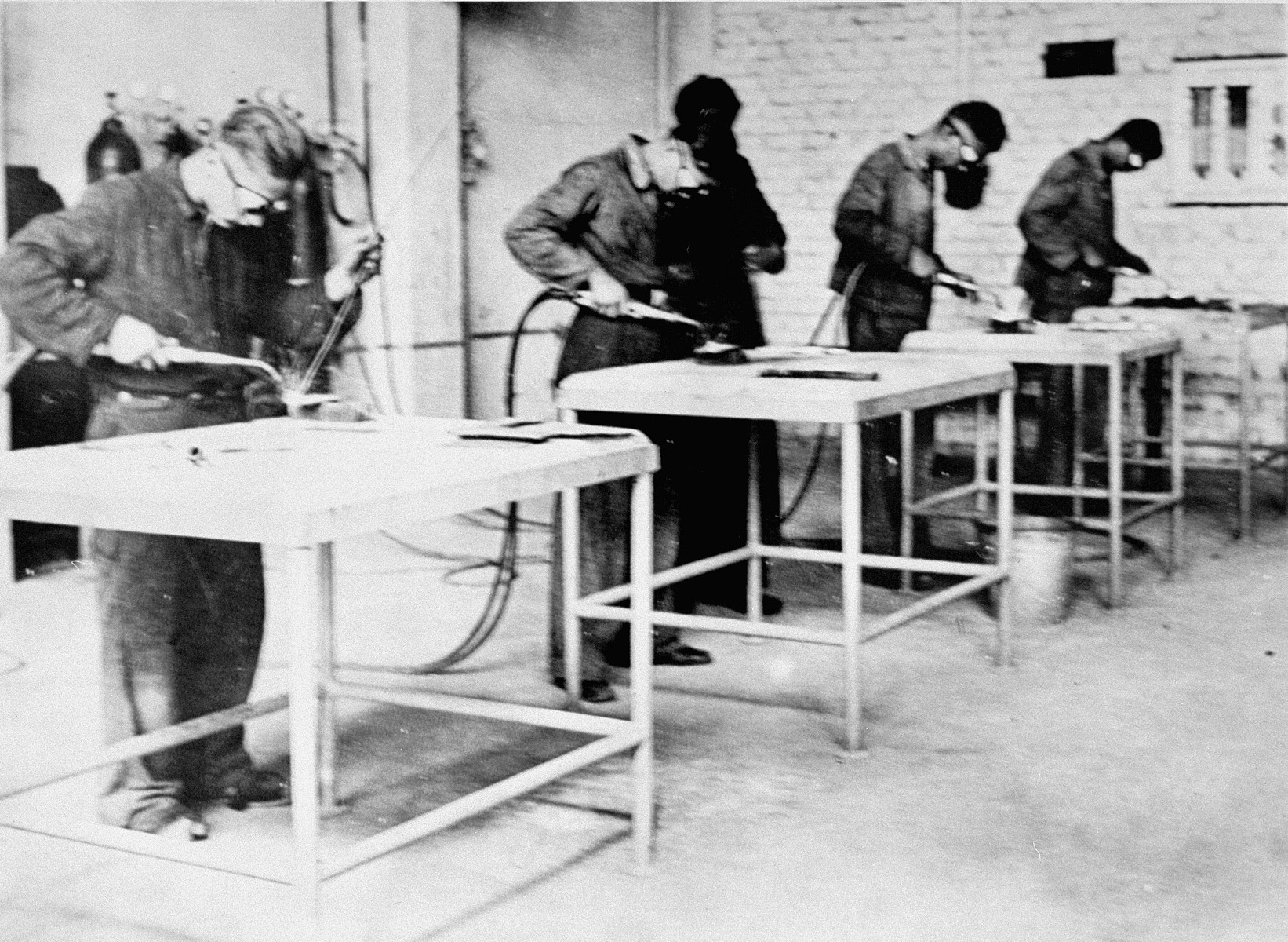 Forced labor in a workshop in Monowitz.
