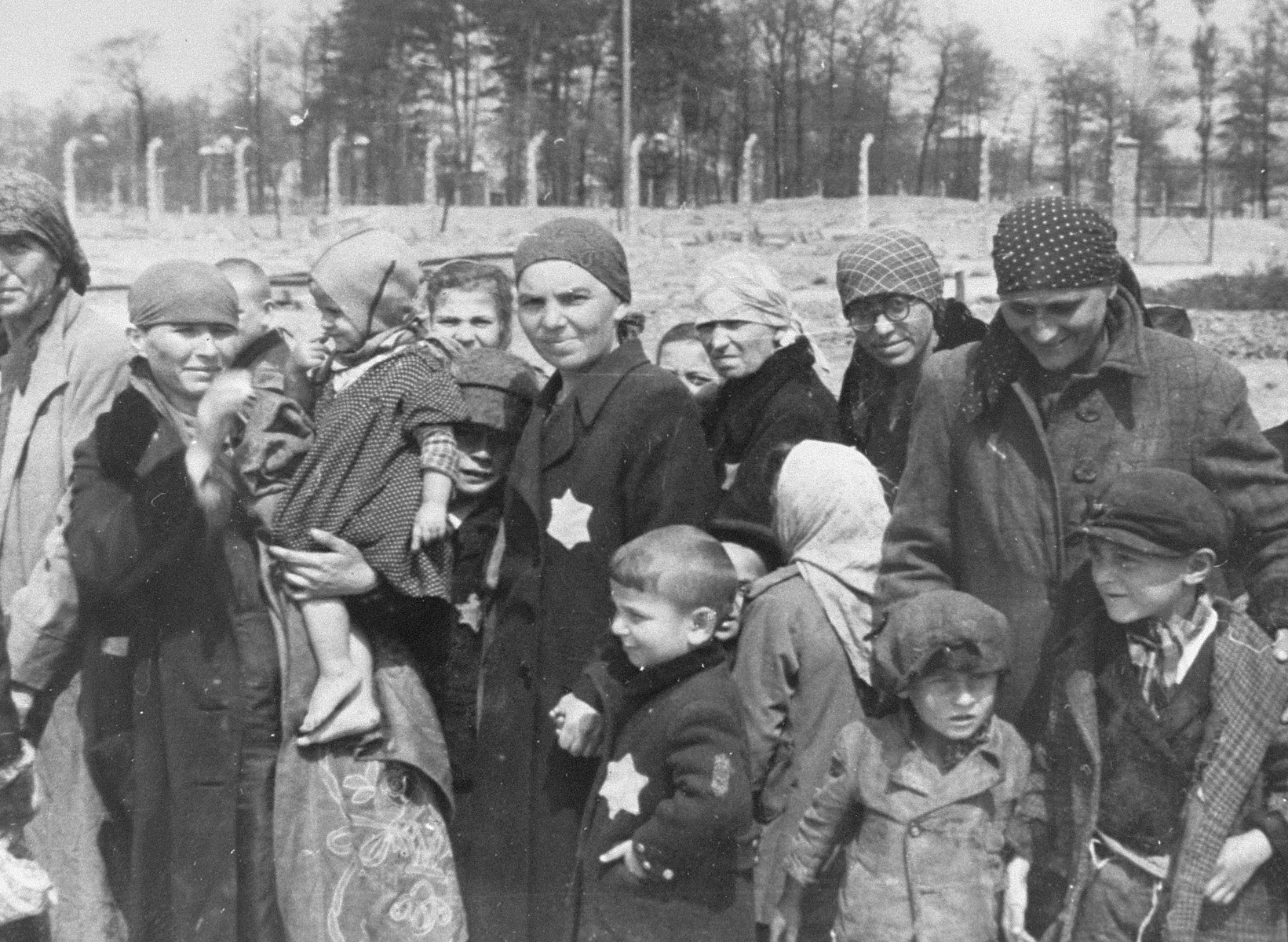 Jewish women and children from Subcarpathian Rus who have been selected for death at Auschwitz-Birkenau, wait to be taken to the gas chambers.