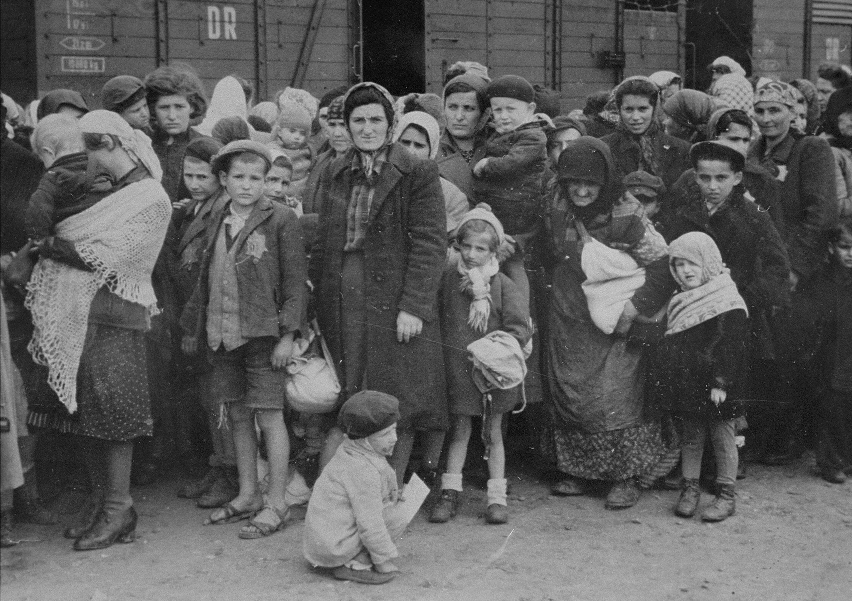 Jewish women and children from Subcarpathian Rus await selection on the ramp at Auschwitz-Birkenau.  Among those pictured are Irina Berkovits (age 37) and her son Adalbert (age 5), both perished.  Also pictured are Hajnal Klein and her four daughters Lili (age 18), Herczi (age 15), Renee (age 12) and Iren (age 7).  Hajnal, Renee and Iren were killed upon arrival.  Lili and Herczi survived.